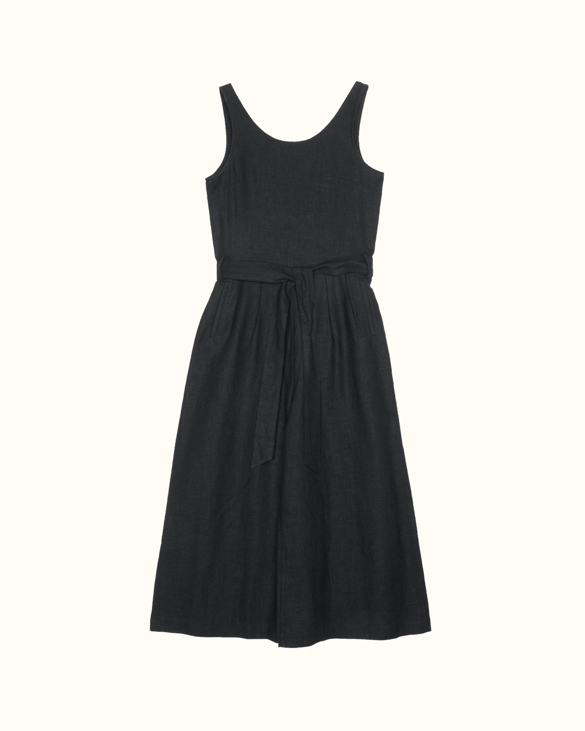 A black sleeveless scoop back linen jumpsuit.