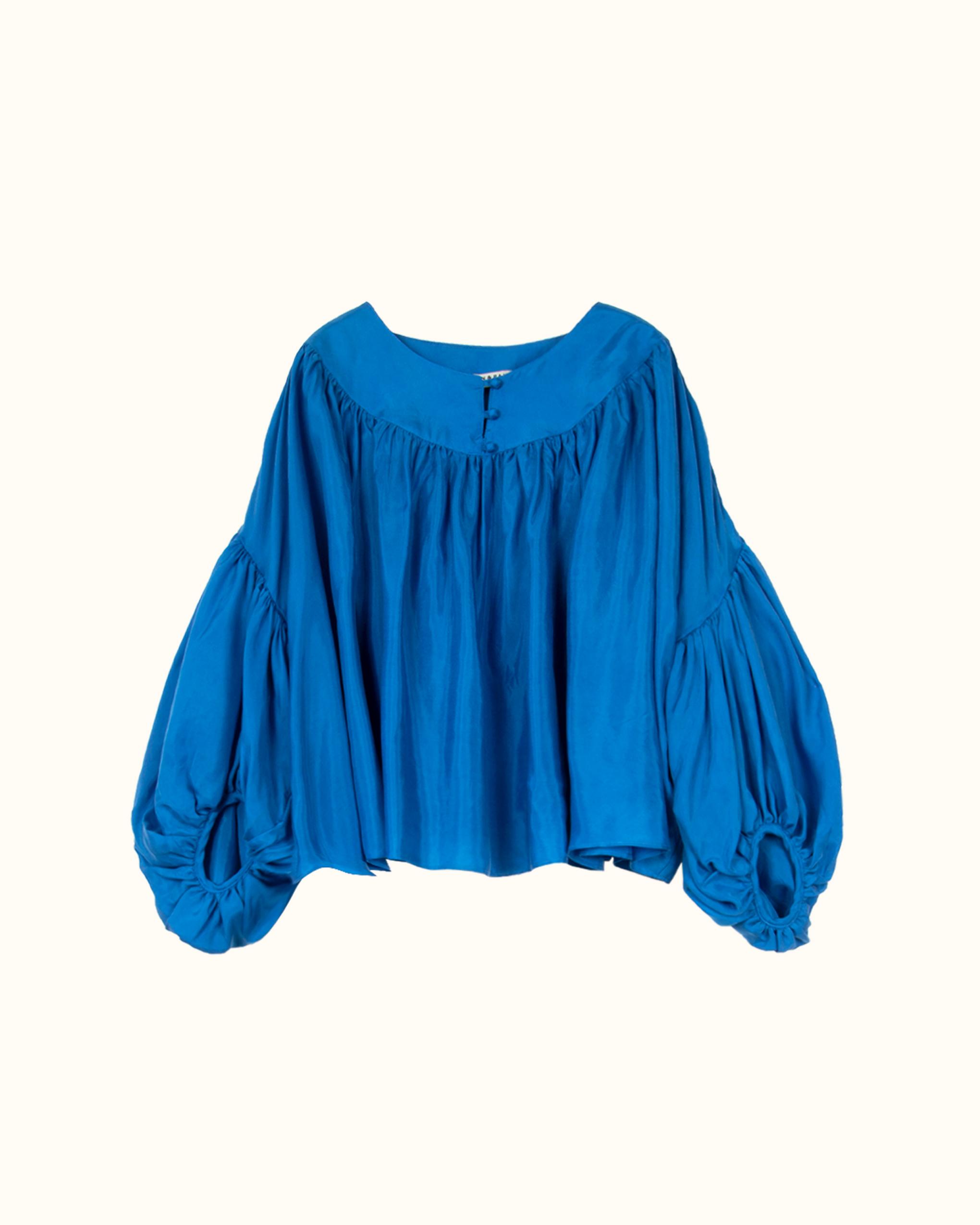 A cobalt blue volume blouse.
