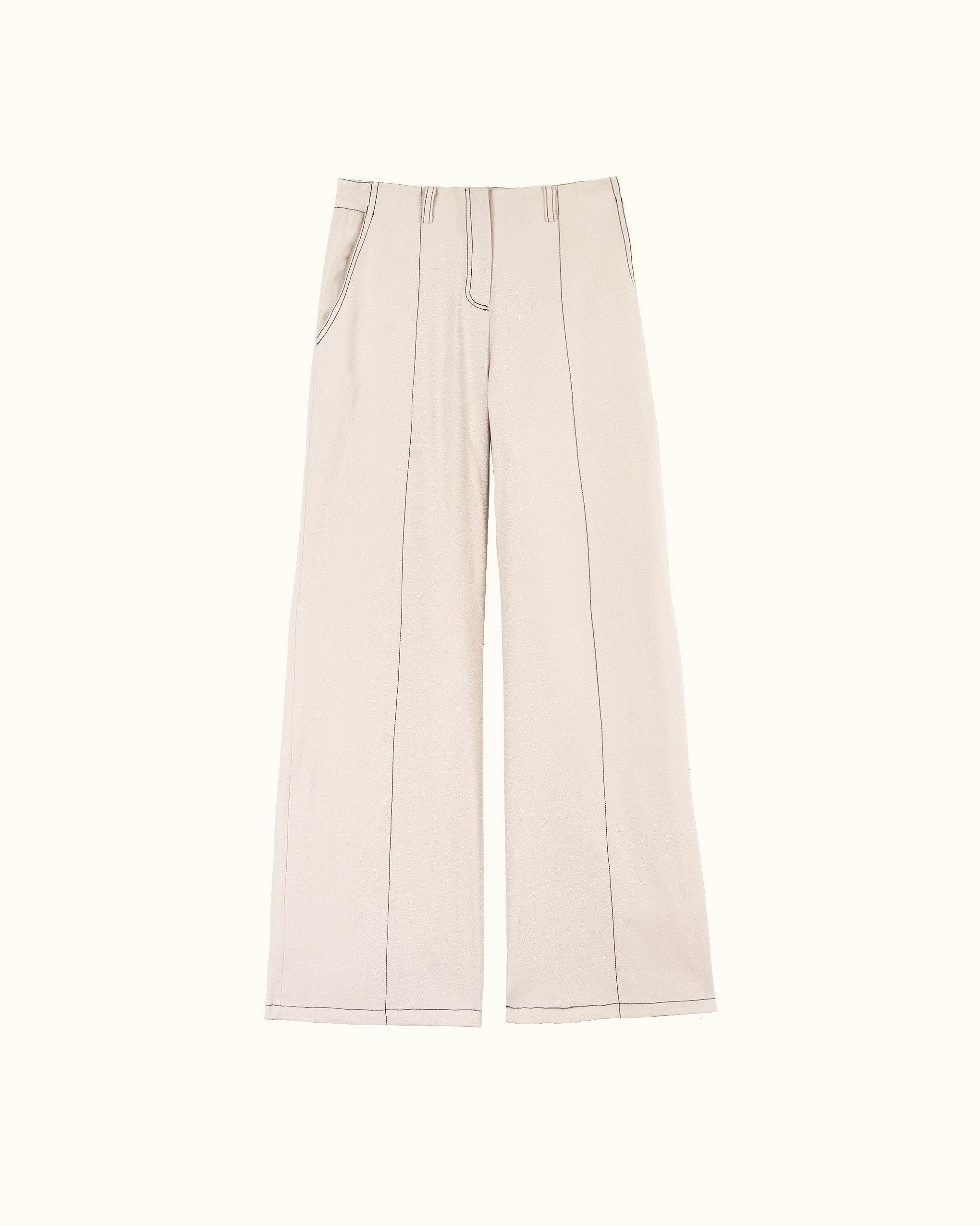 A contrast stitch cream trousers.