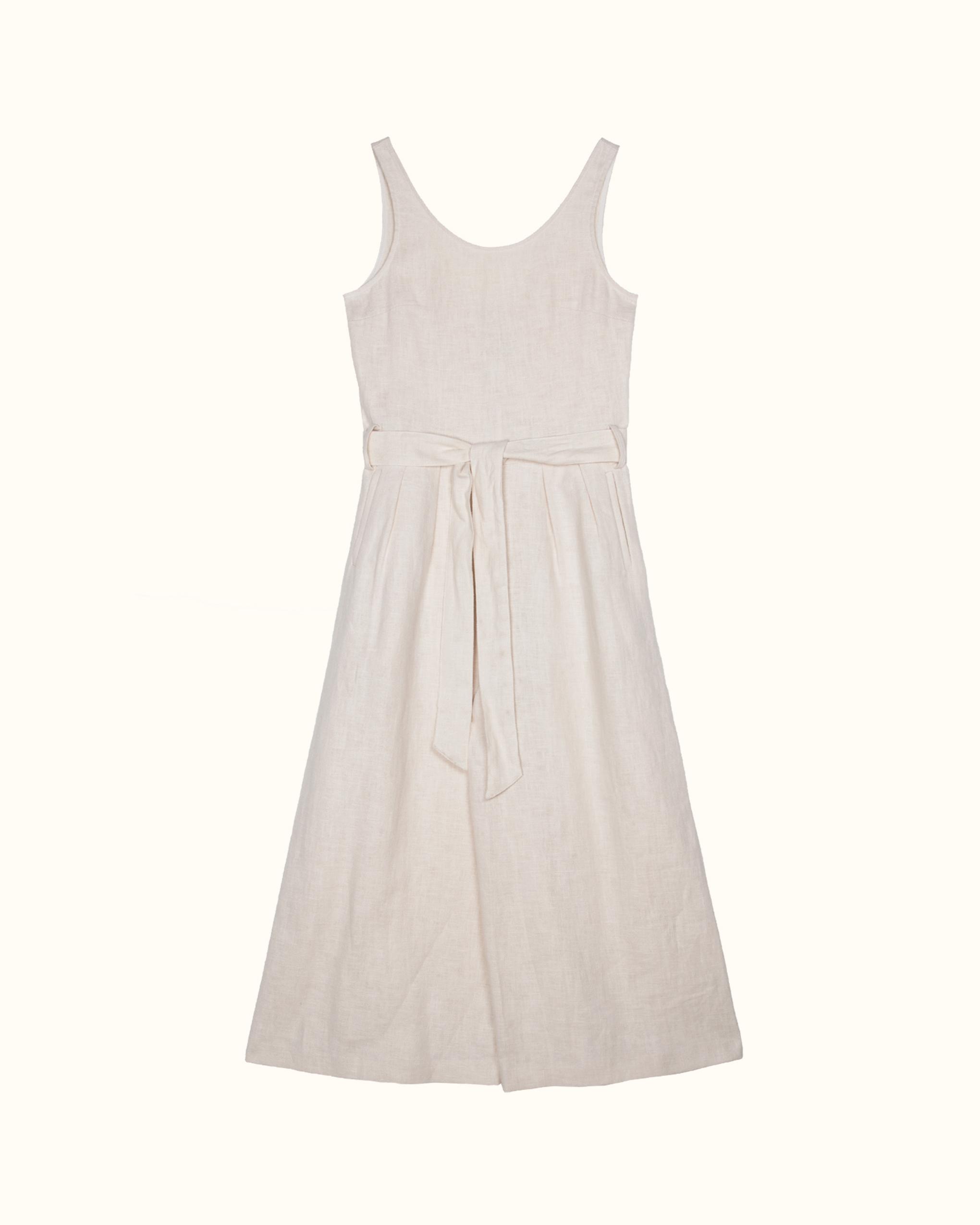White sleeveless scoop back linen jumpsuit.