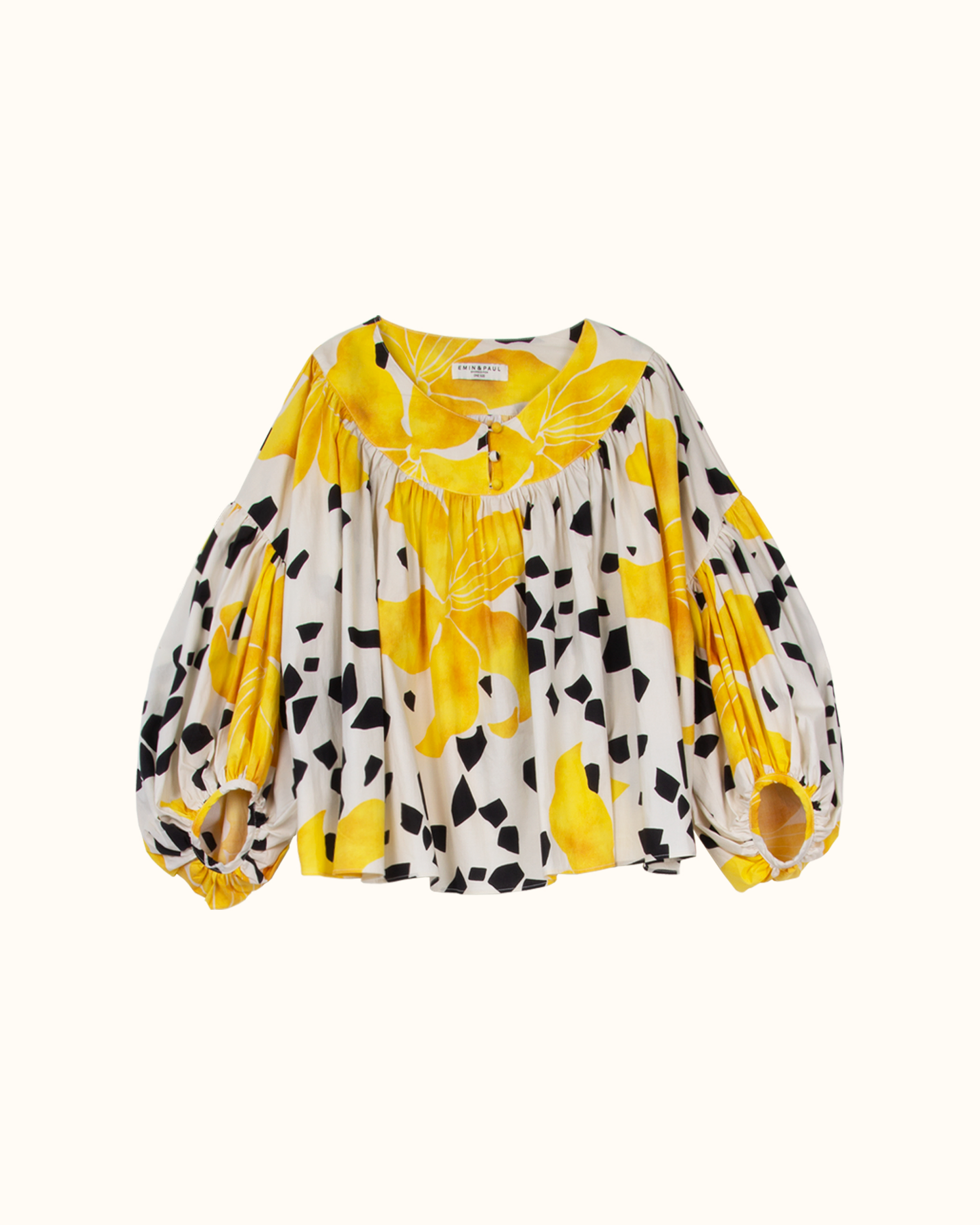 A yellow flower and black dot pattern blouse.