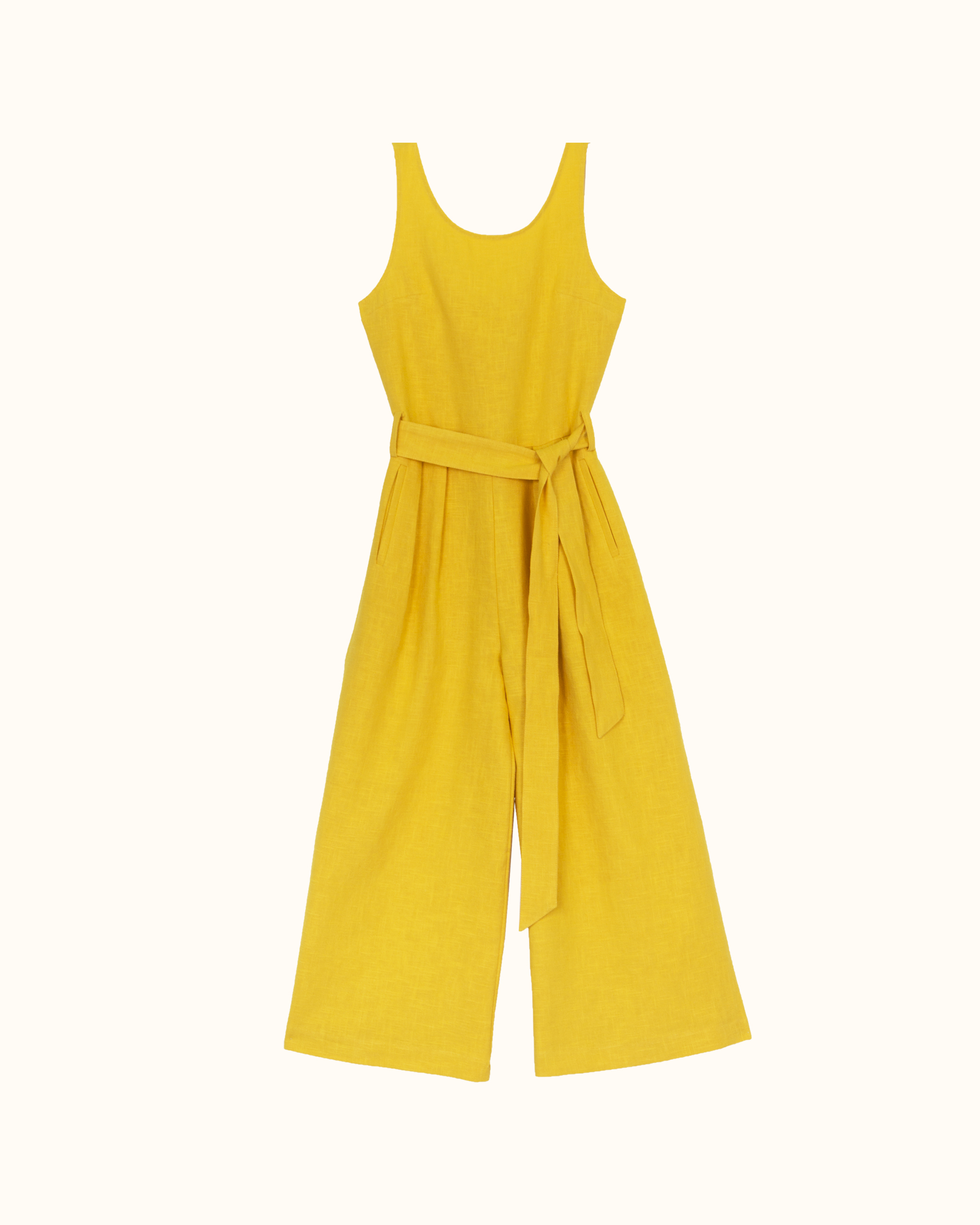 A yellow sleeveless scoop back linen jumpsuit.