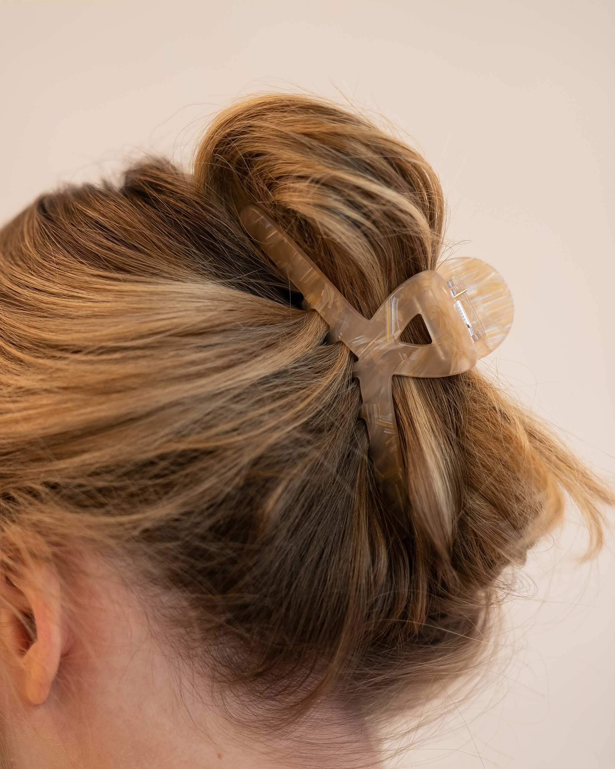 Model wearing Emin + Paul buttermilk angular hair claw.