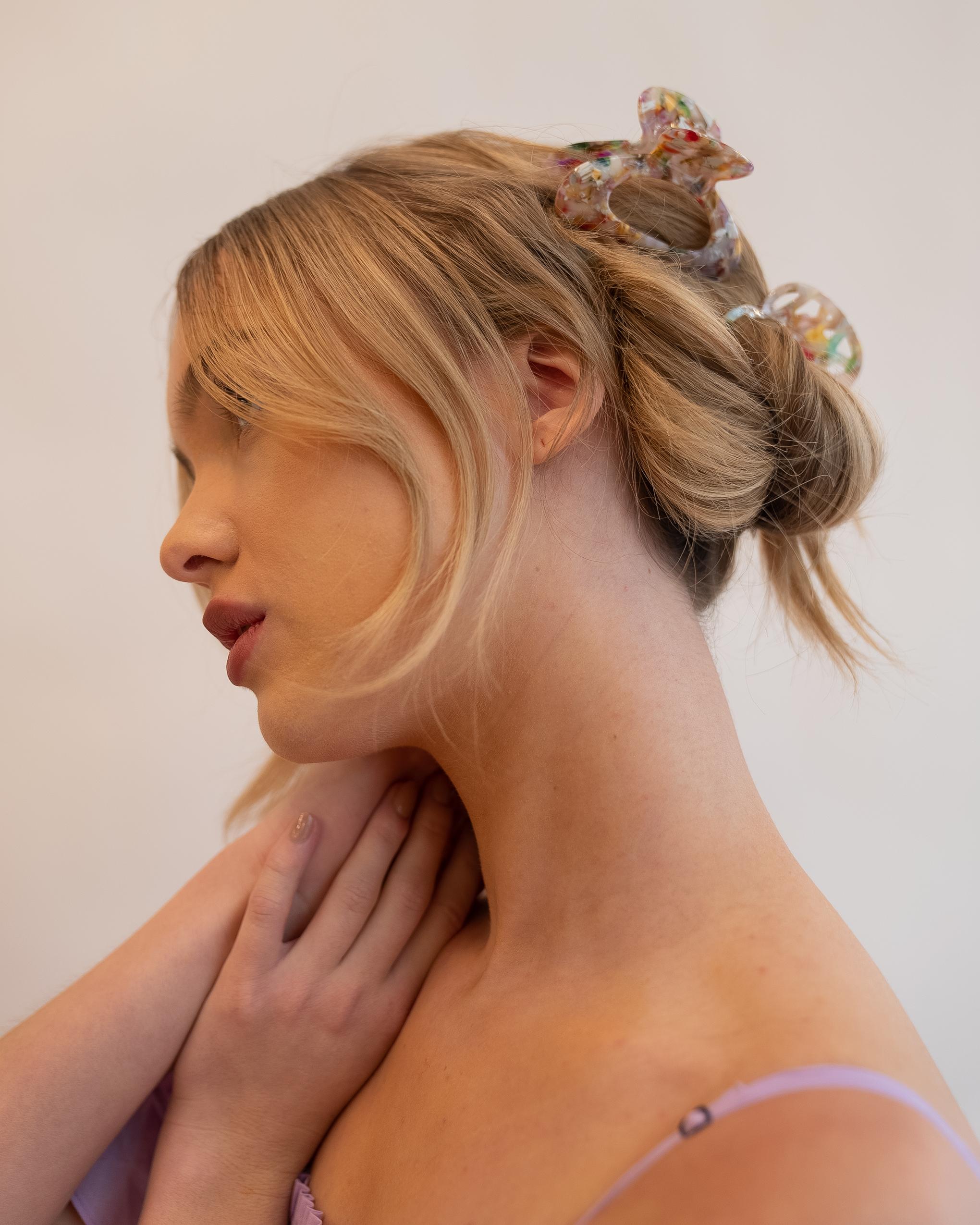 Model wearing Emin + Paul confetti cut out hair claw.