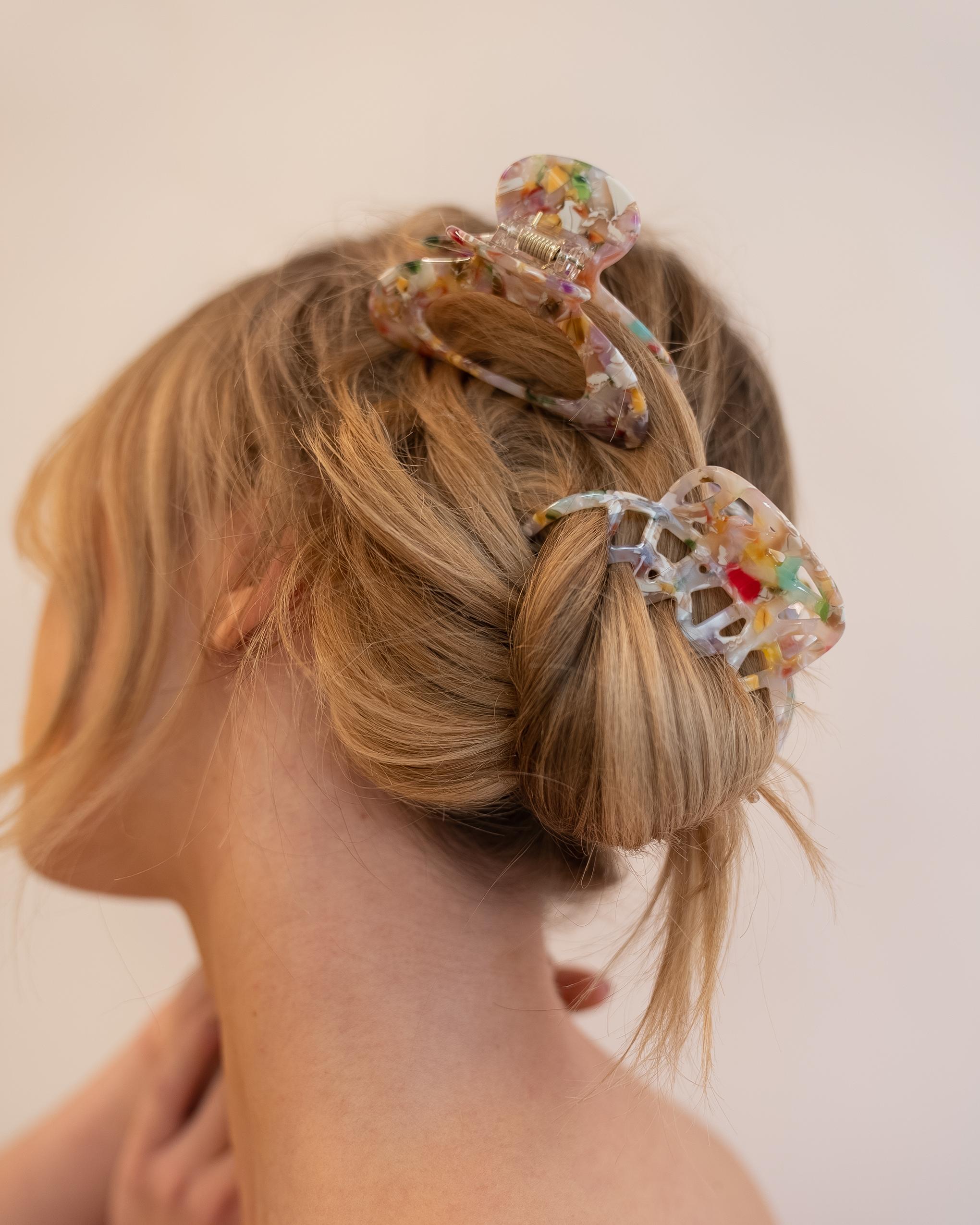 Model wearing Emin + Paul confetti lattice hair claw.