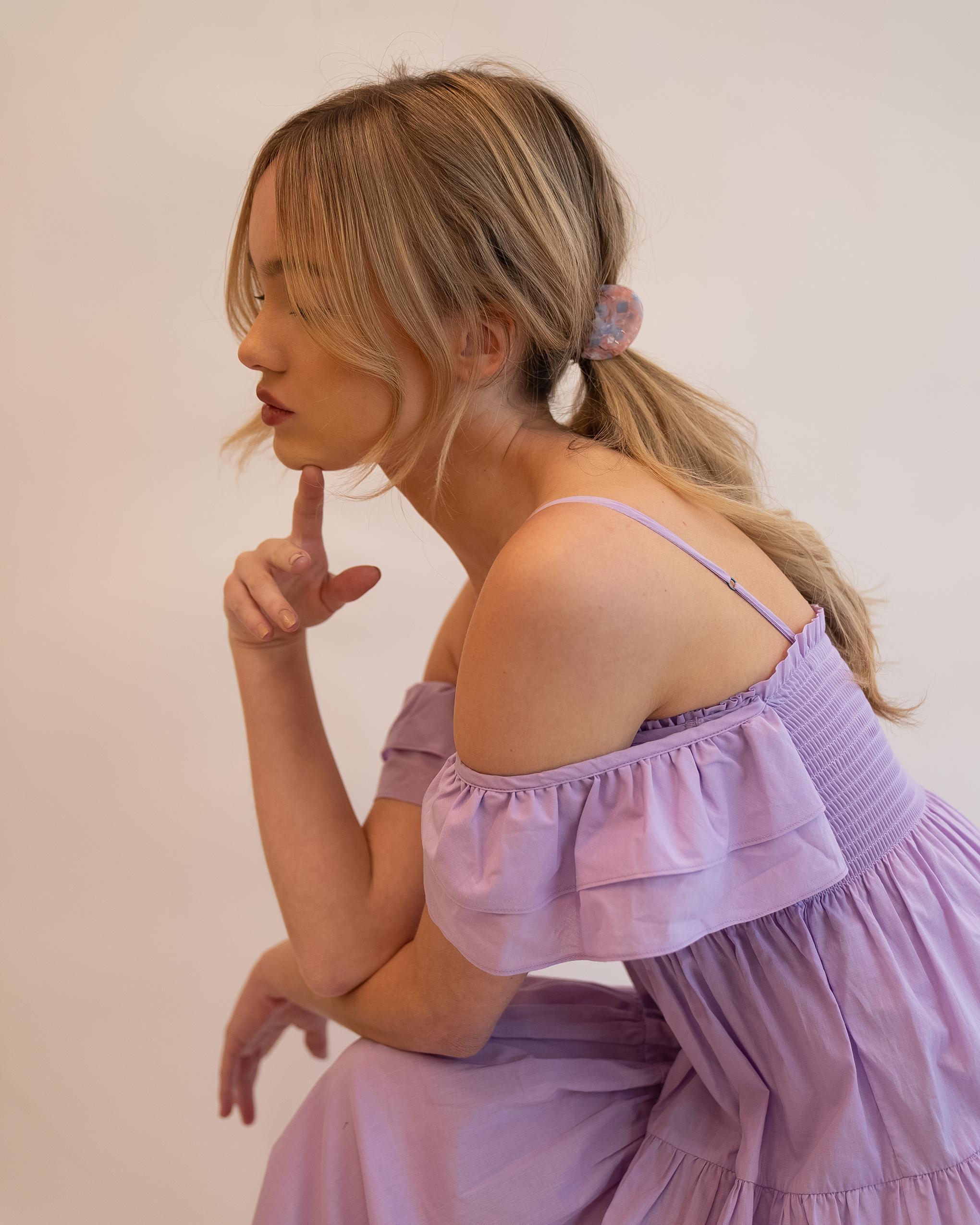 Model wearing Emin + Paul hydrangea wing hair claw.