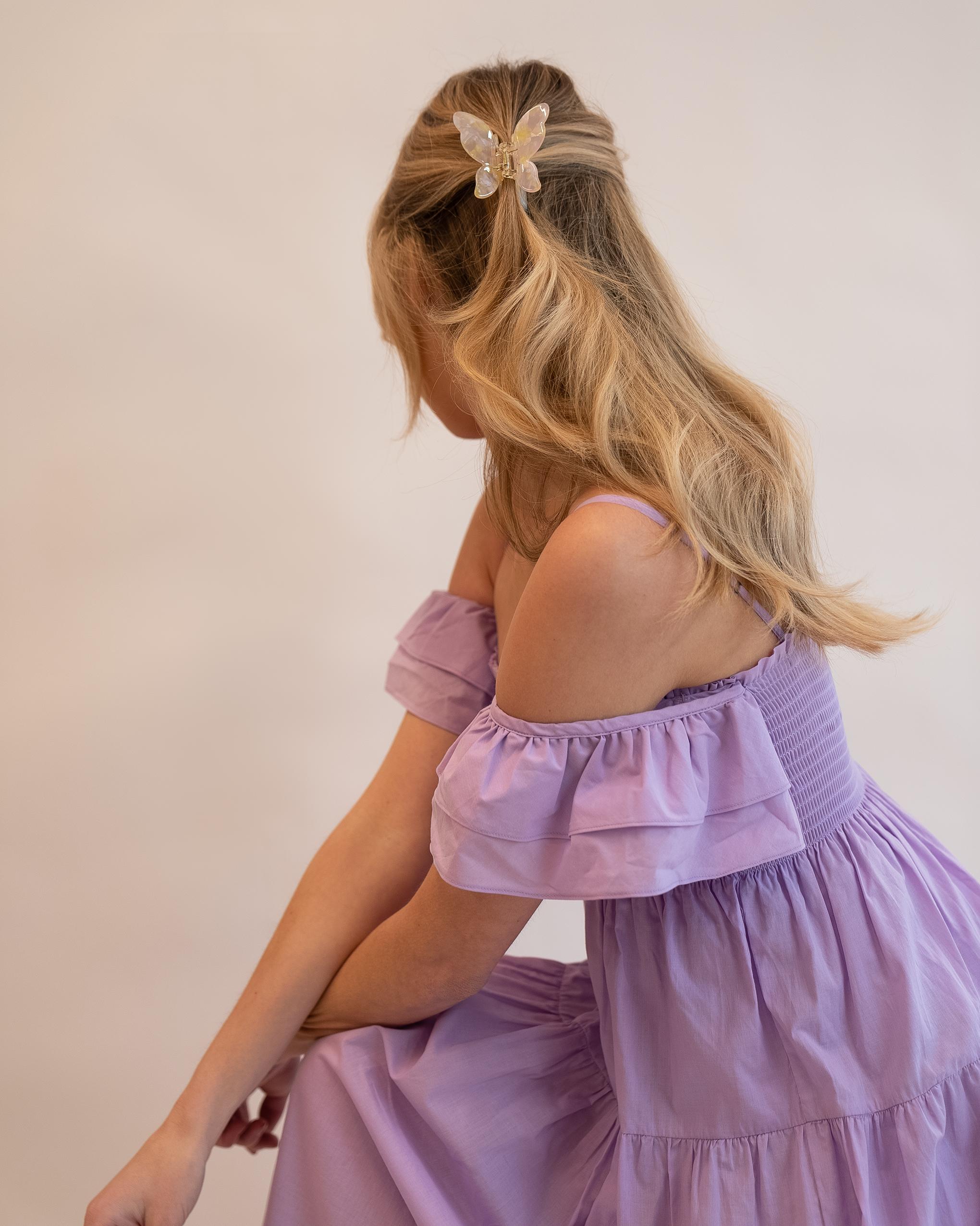 Model wearing Emin + Paul lemon blush butterfly hair claw.
