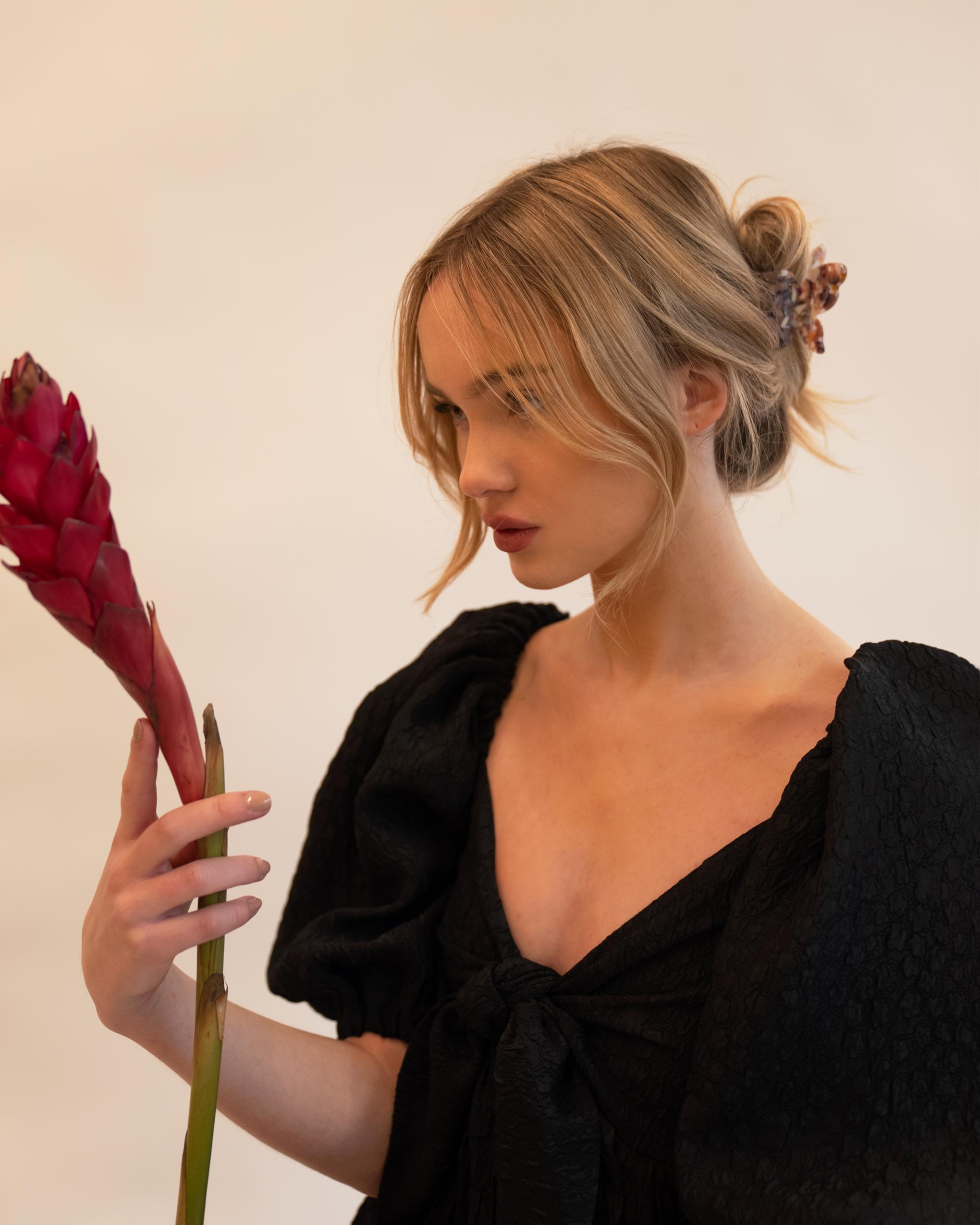 Model wearing Emin + Paul orchid butterfly hair claw.