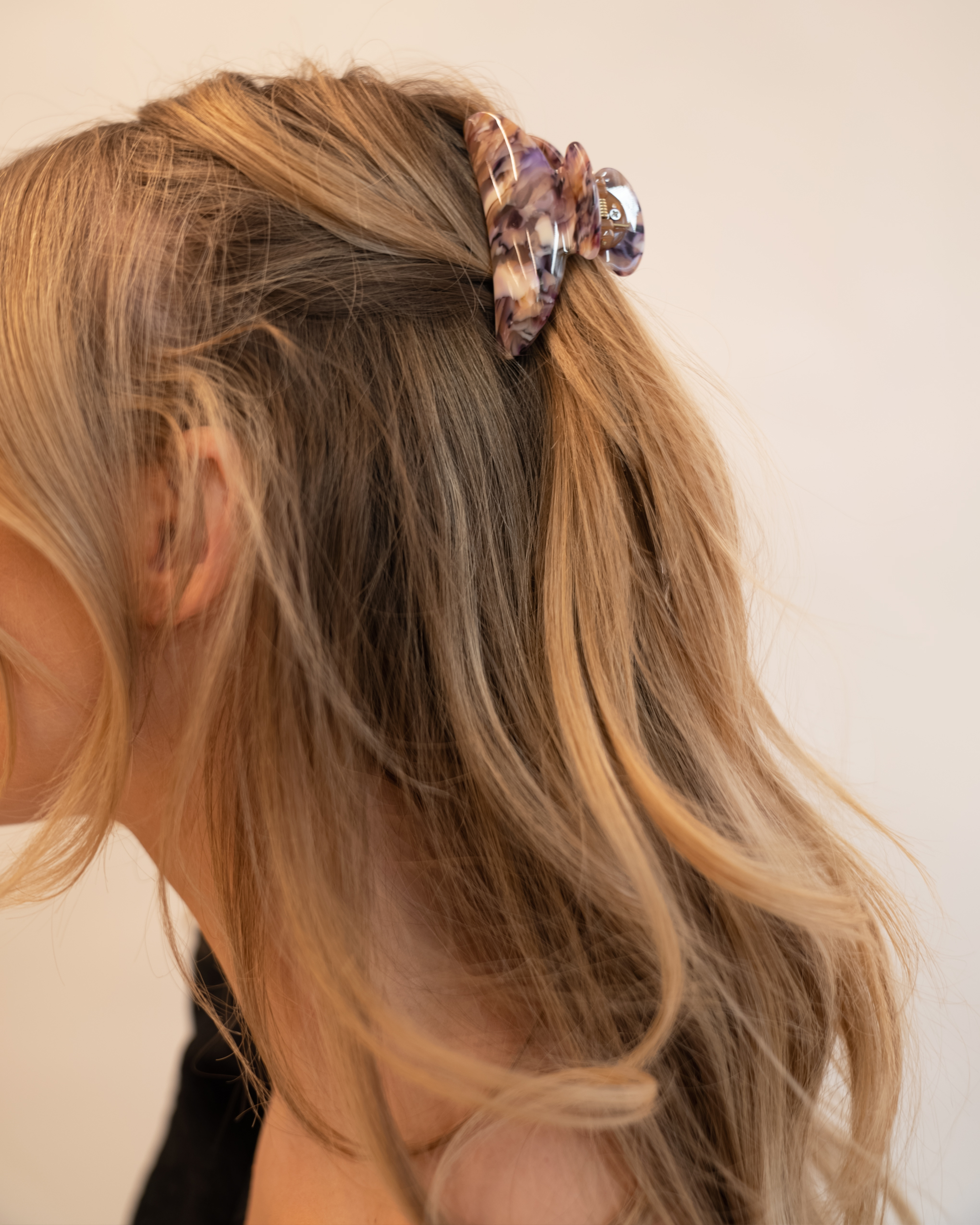 Model wearing Emin + Paul orchid crescent hair claw.