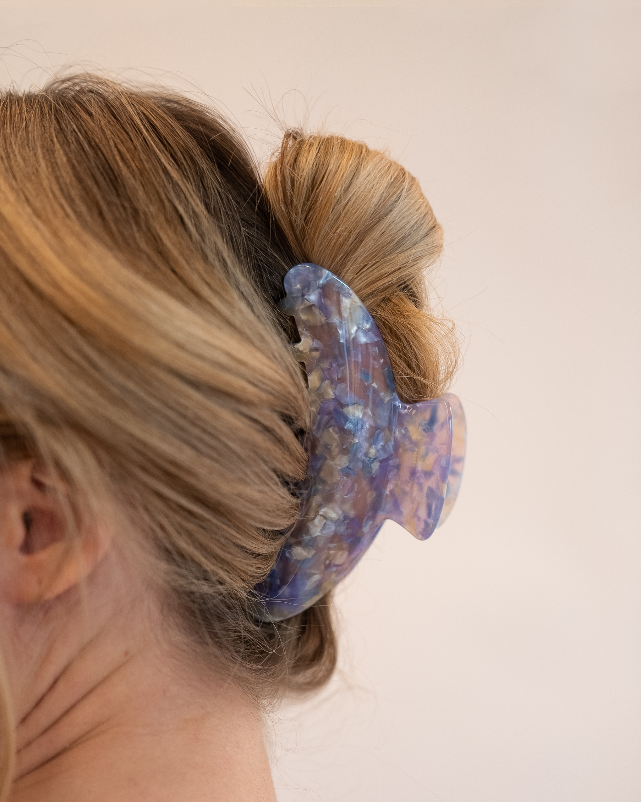 Model wearing Emin + Paul parma violet chunky crescent hair claw.