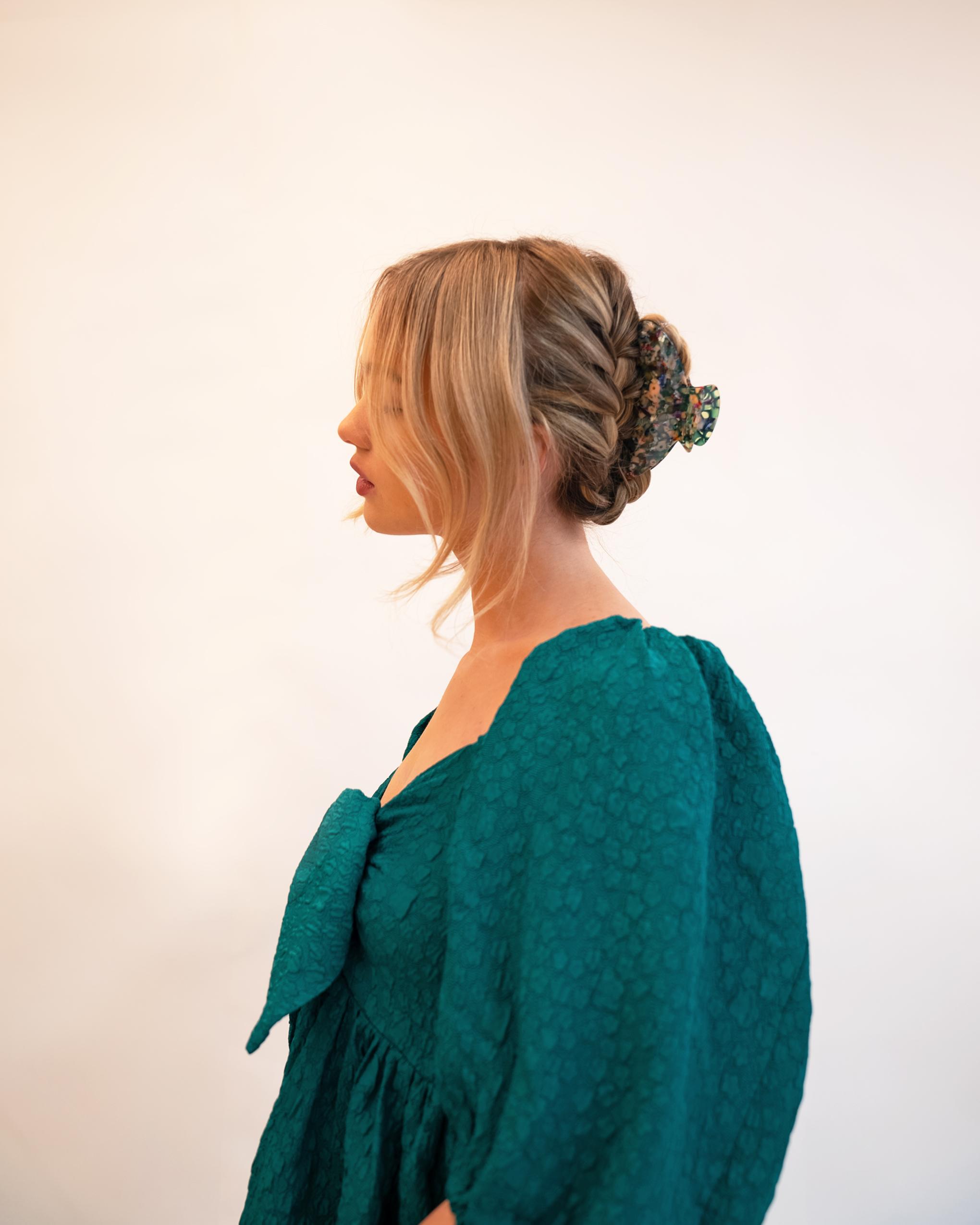 Model wearing Emin + Paul rose garden chunky crescent hair claw.