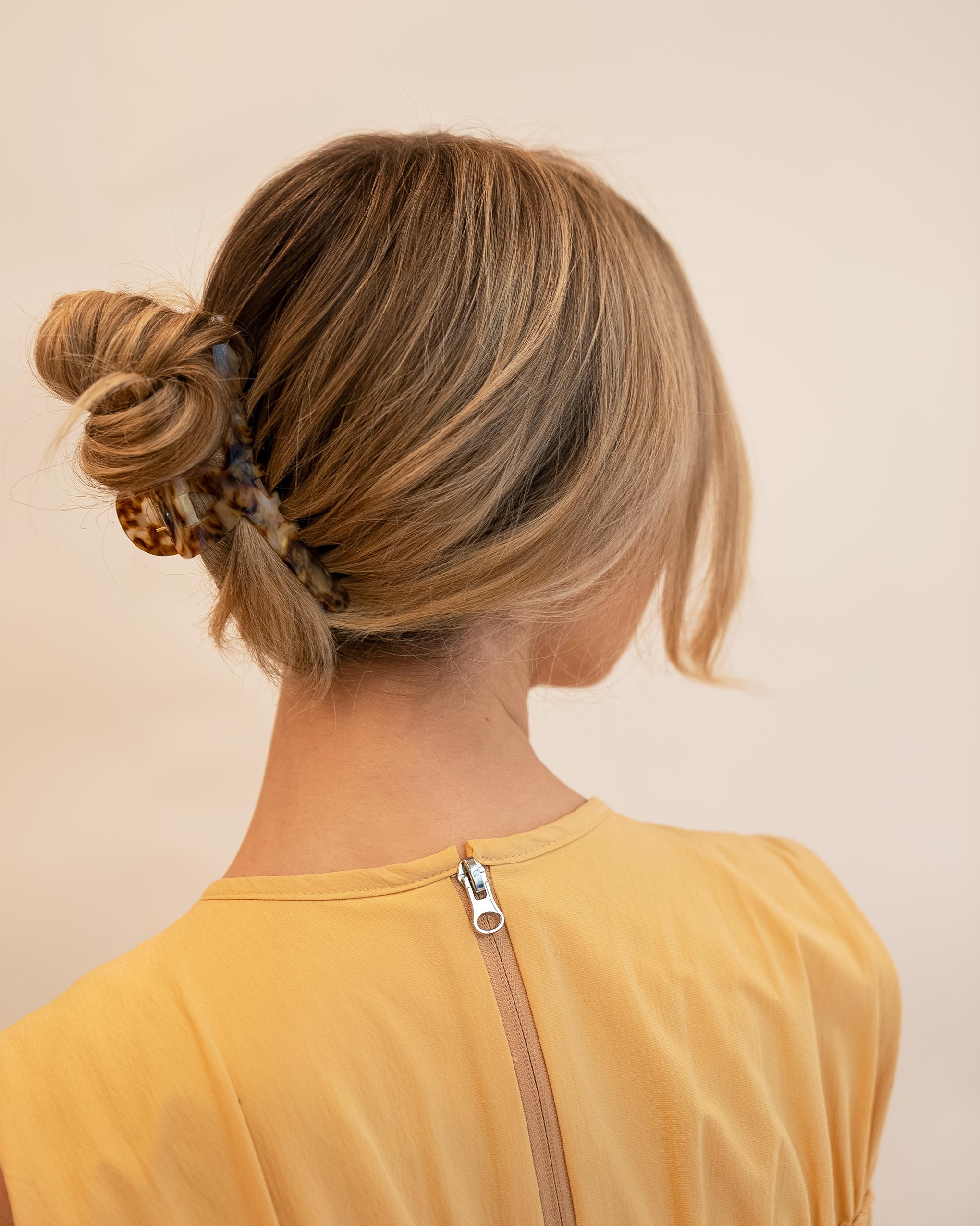 Model wearing Emin + Paul tortoiseshell angular hair claw.