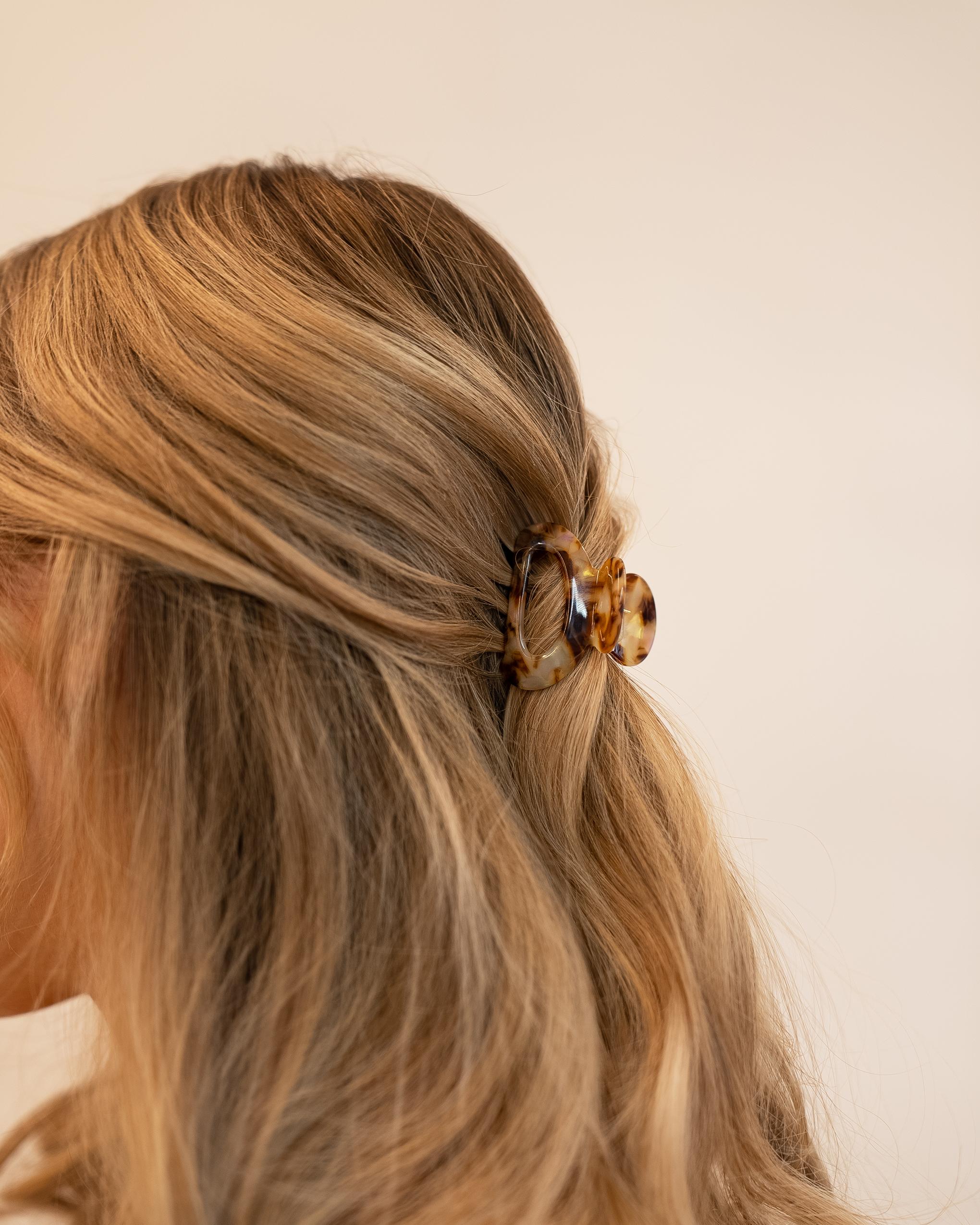 Model wearing Emin + Paul tortoiseshell mini cut out hair claw.