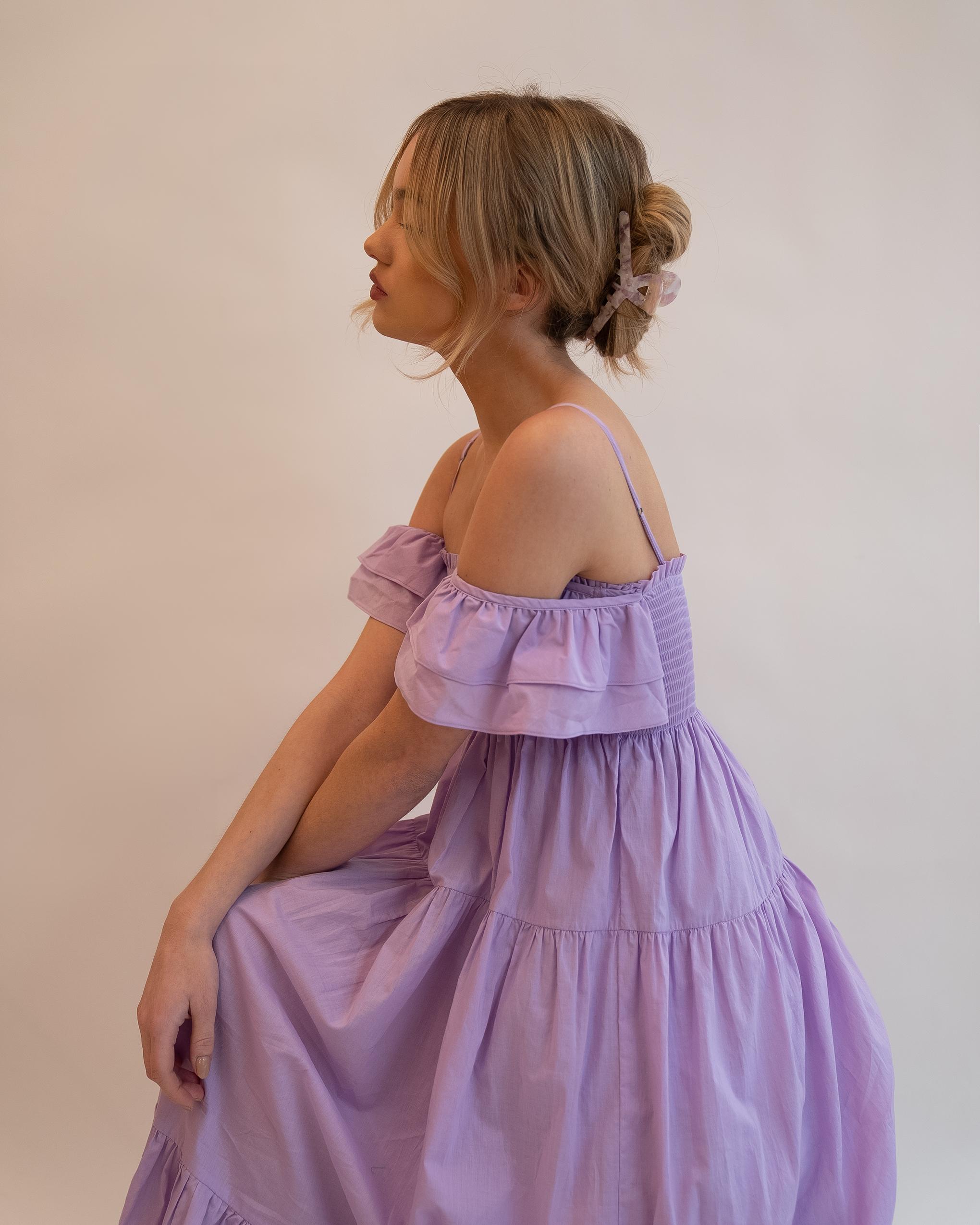 Model wearing Emin + Paul violet opal angular hair claw.