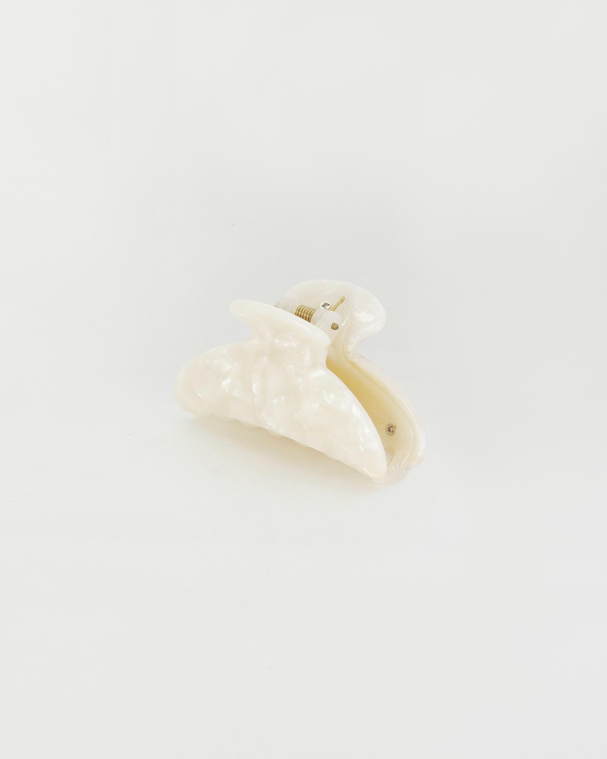 Emin + Paul white opal crescent hair claw.
