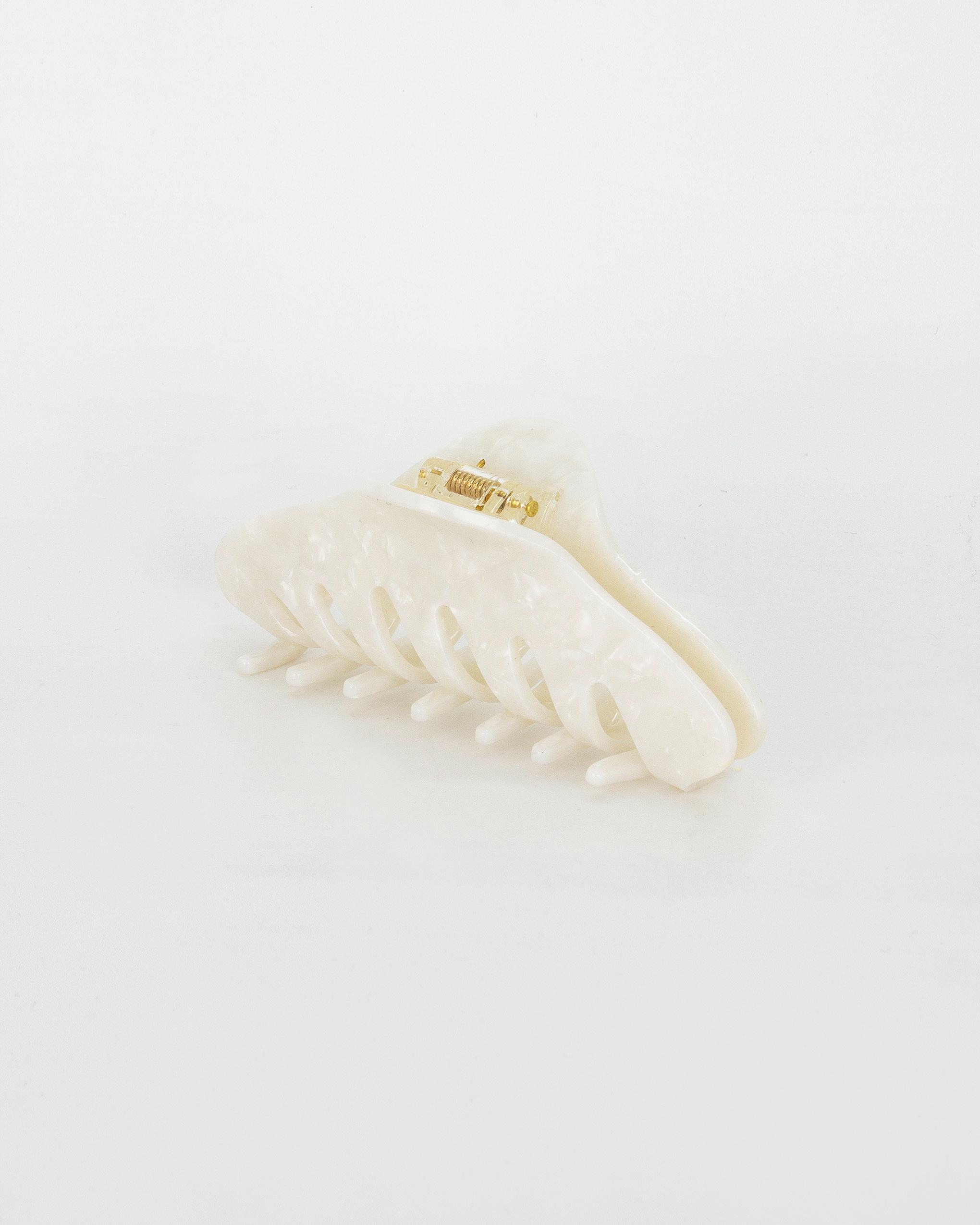 Emin + Paul white opal twist hair claw.