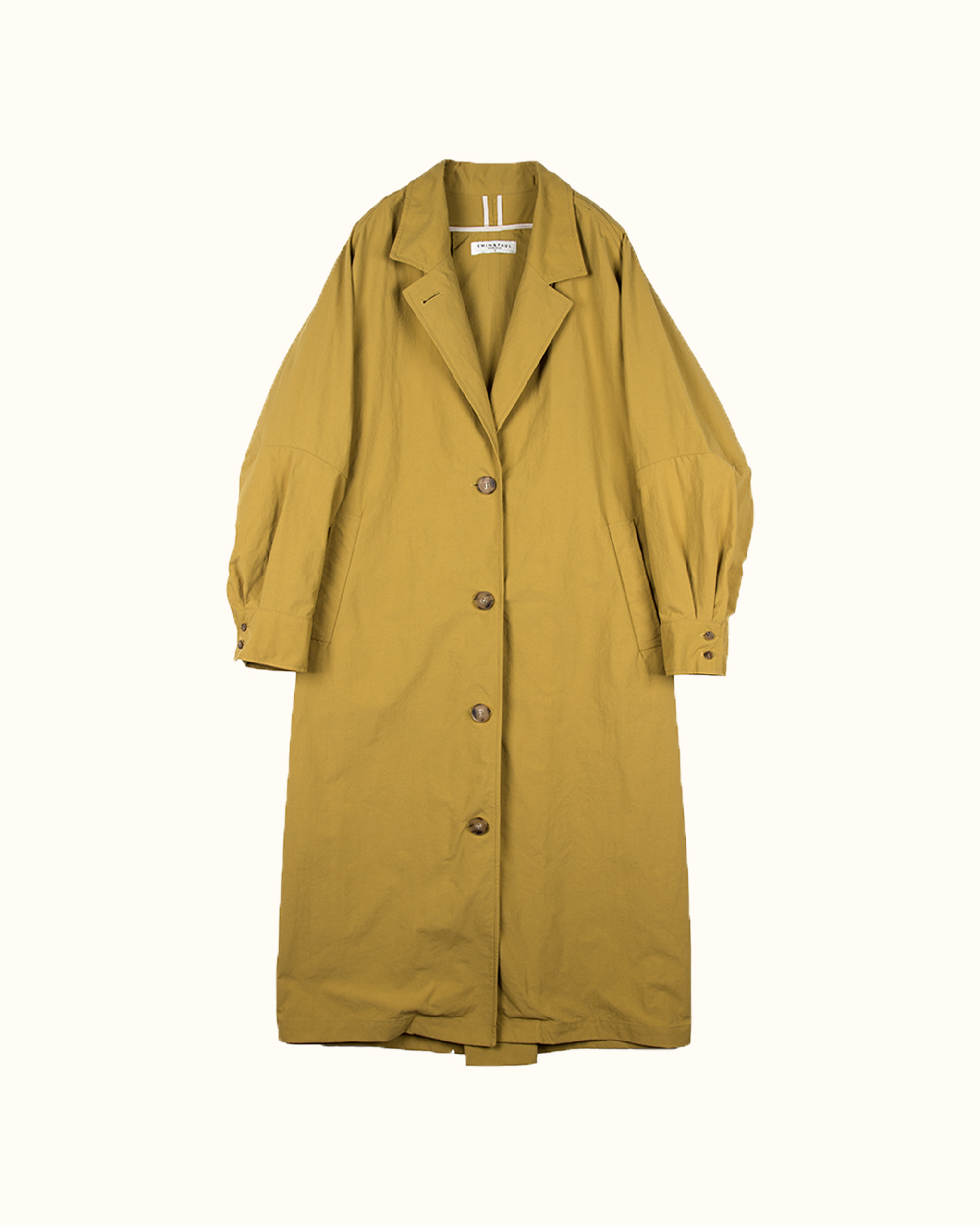A mustard volume sleeve cotton blend trench coat.