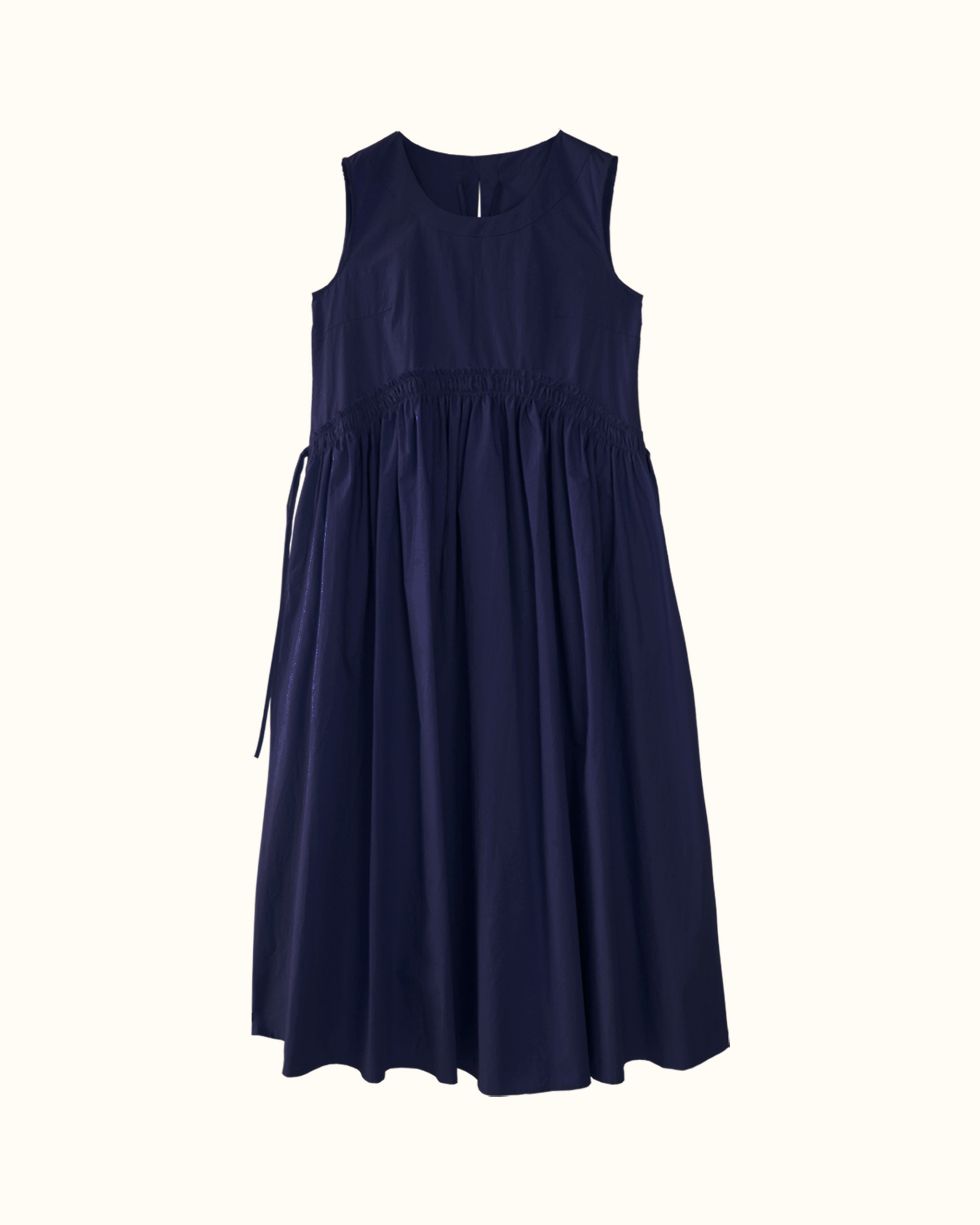 A navy curved shirred waist side tie dress.