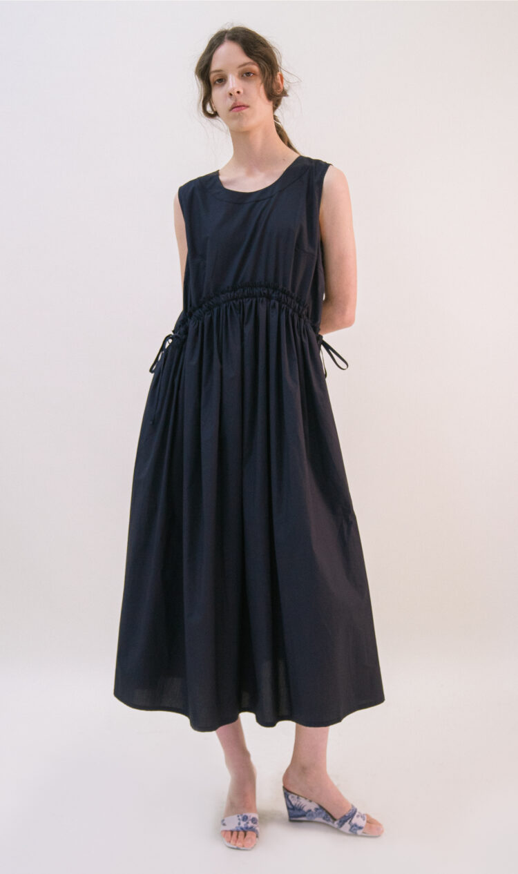 Navy curved shirred waist side tie dress