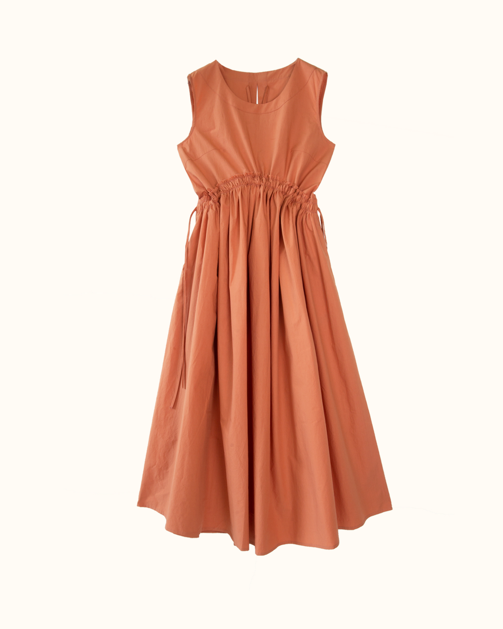 An orange curved shirred waist side tie dress.