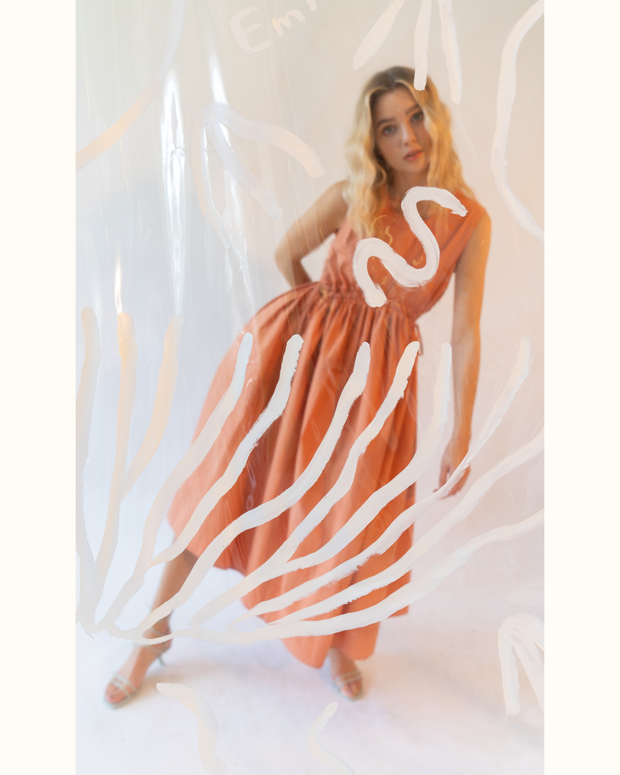 https://eminandpaul.com/app/uploads/2021/05/orange-curved-shirred-waist-side-tie-dress-2.jpg