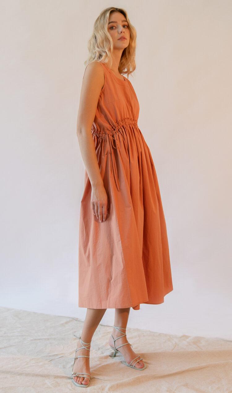 Orange curved shirred waist side tie dress