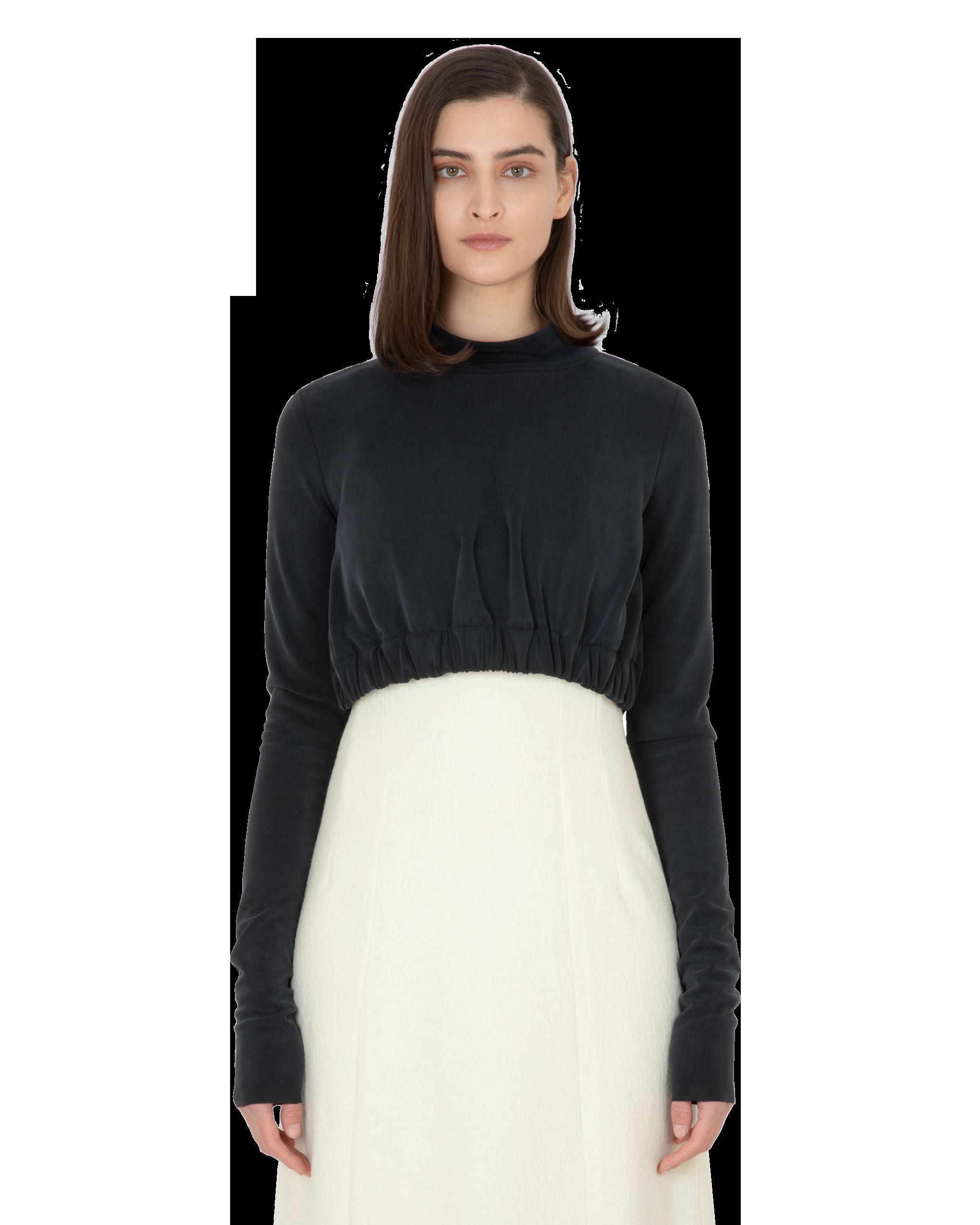 Model wearing EMIN + PAUL black cropped jersey jumper.