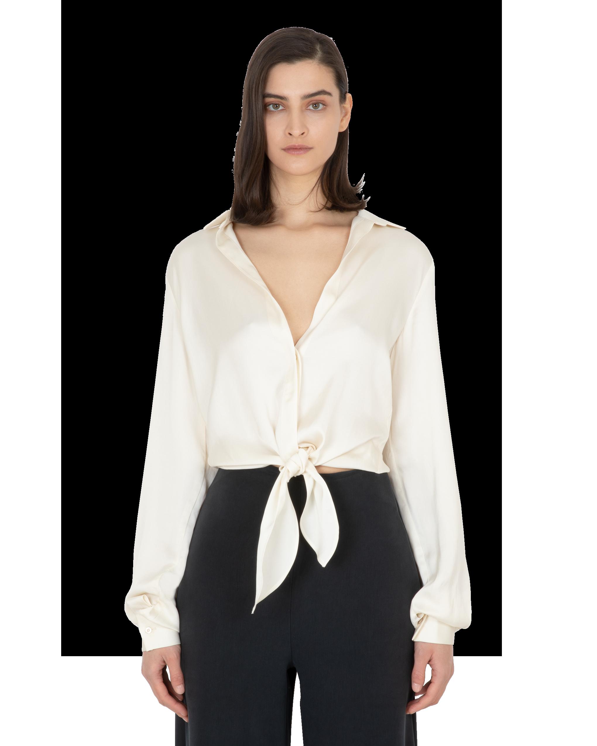 Model wearing EMIN + PAUL cream tie-front blouse.