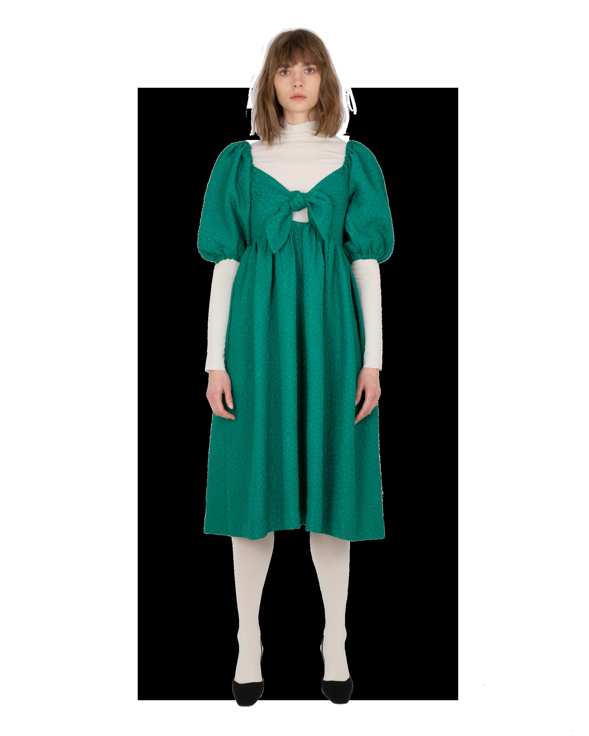 Model wearing EMIN + PAUL green puff sleeve dress.
