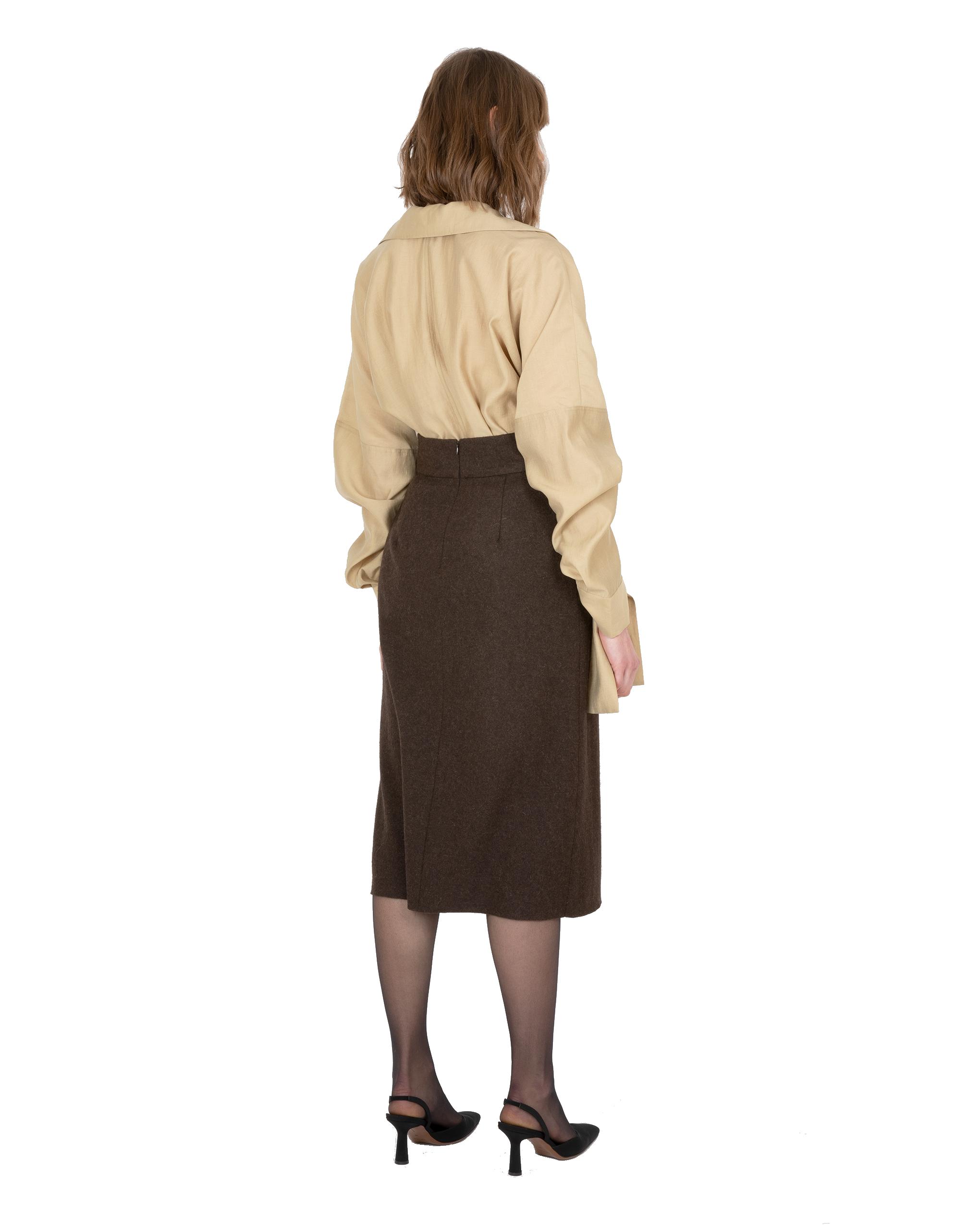Model wearing EMIN + PAUL khaki ruched sleeve blouse.