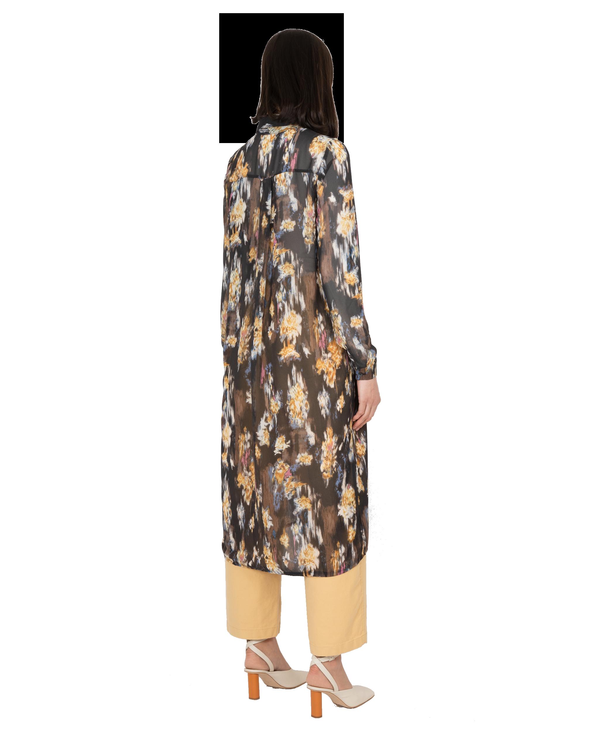 Model wearing EMIN + PAUL multi printed shirt dress.