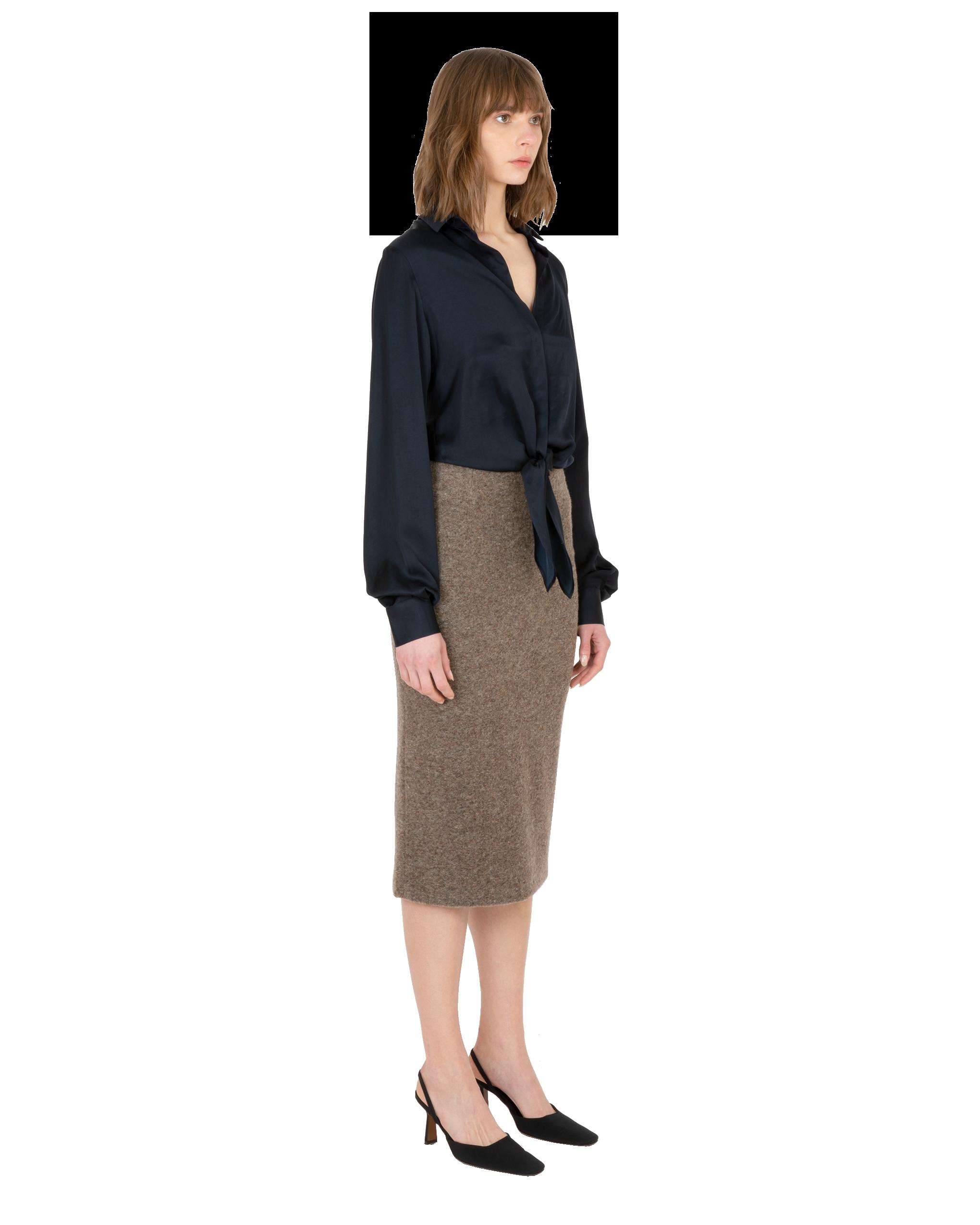 Model wearing EMIN + PAUL navy tie-front blouse.