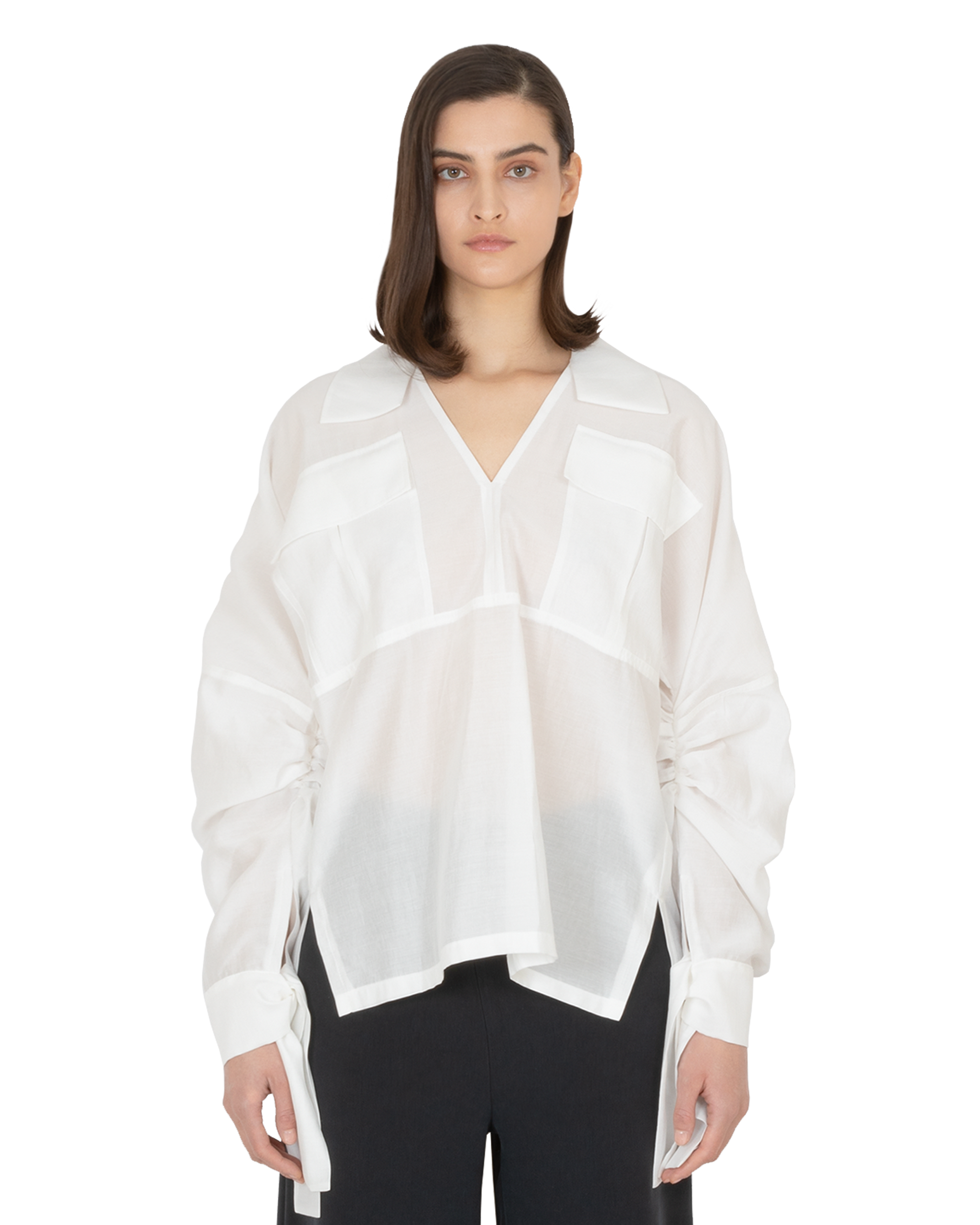 Model wearing EMIN + PAUL white ruched sleeve blouse.