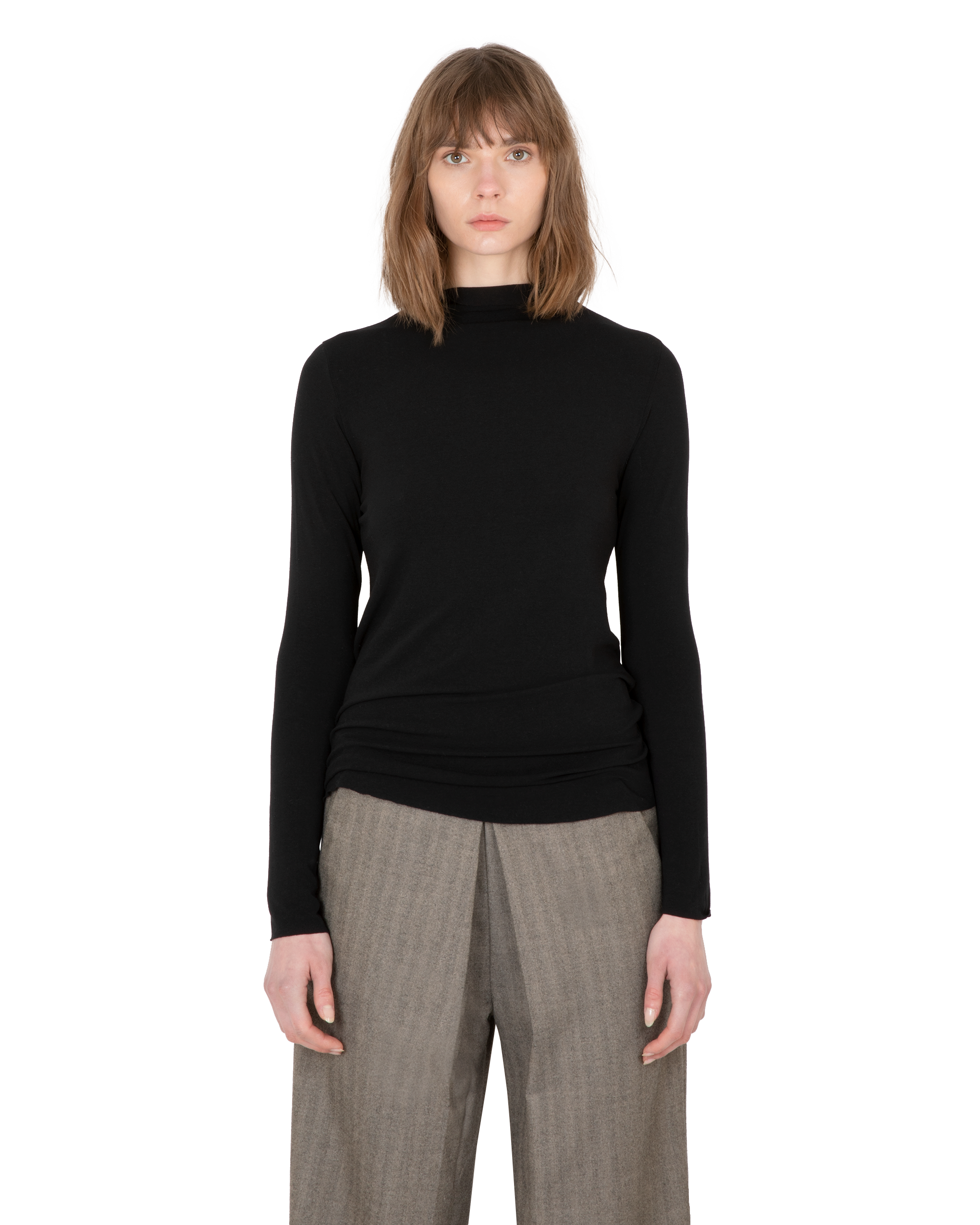 Model wearing EMIN + PAUL black second skin jersey blouse.