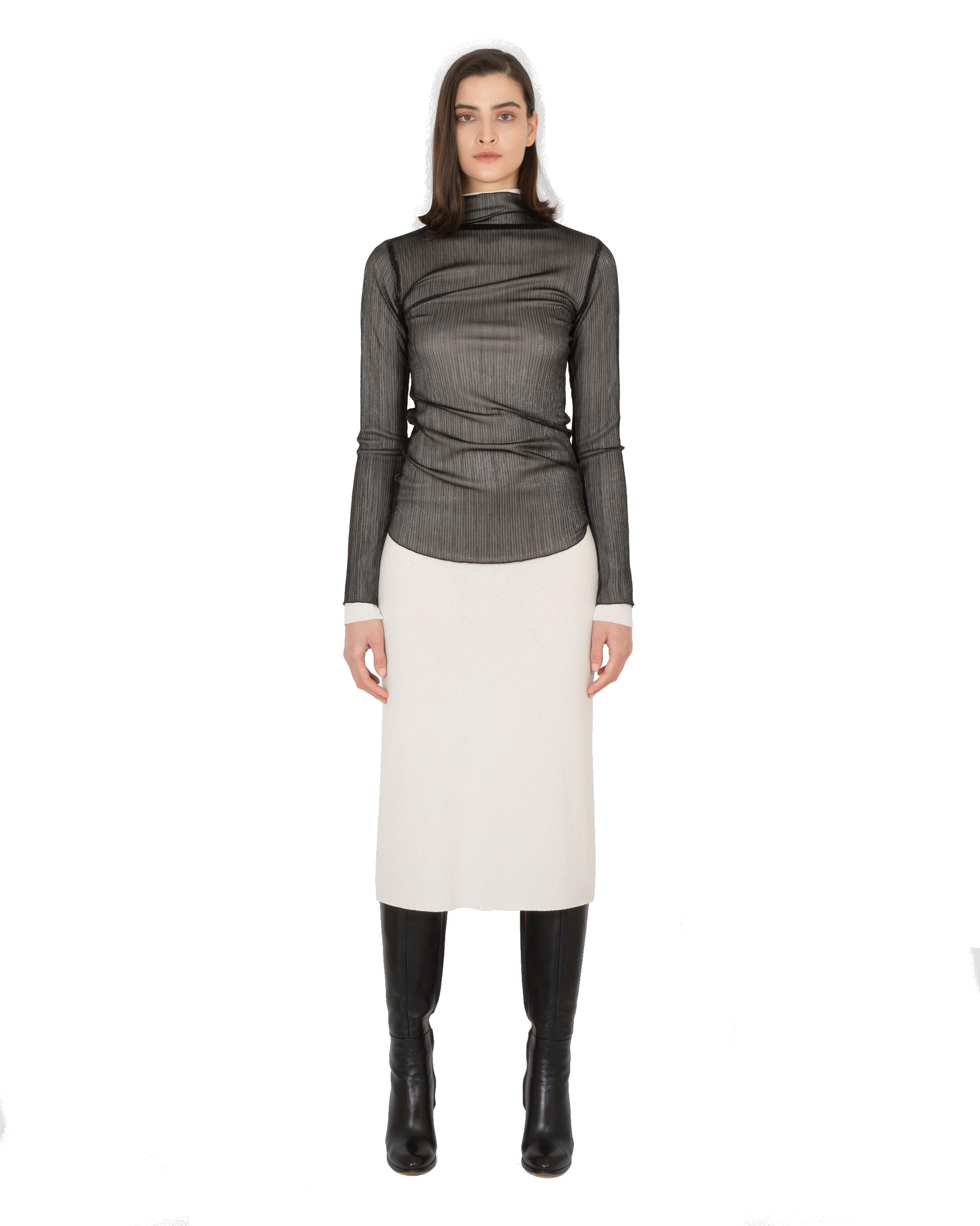 Model wearing EMIN + PAUL black shine lettuce edge blouse.