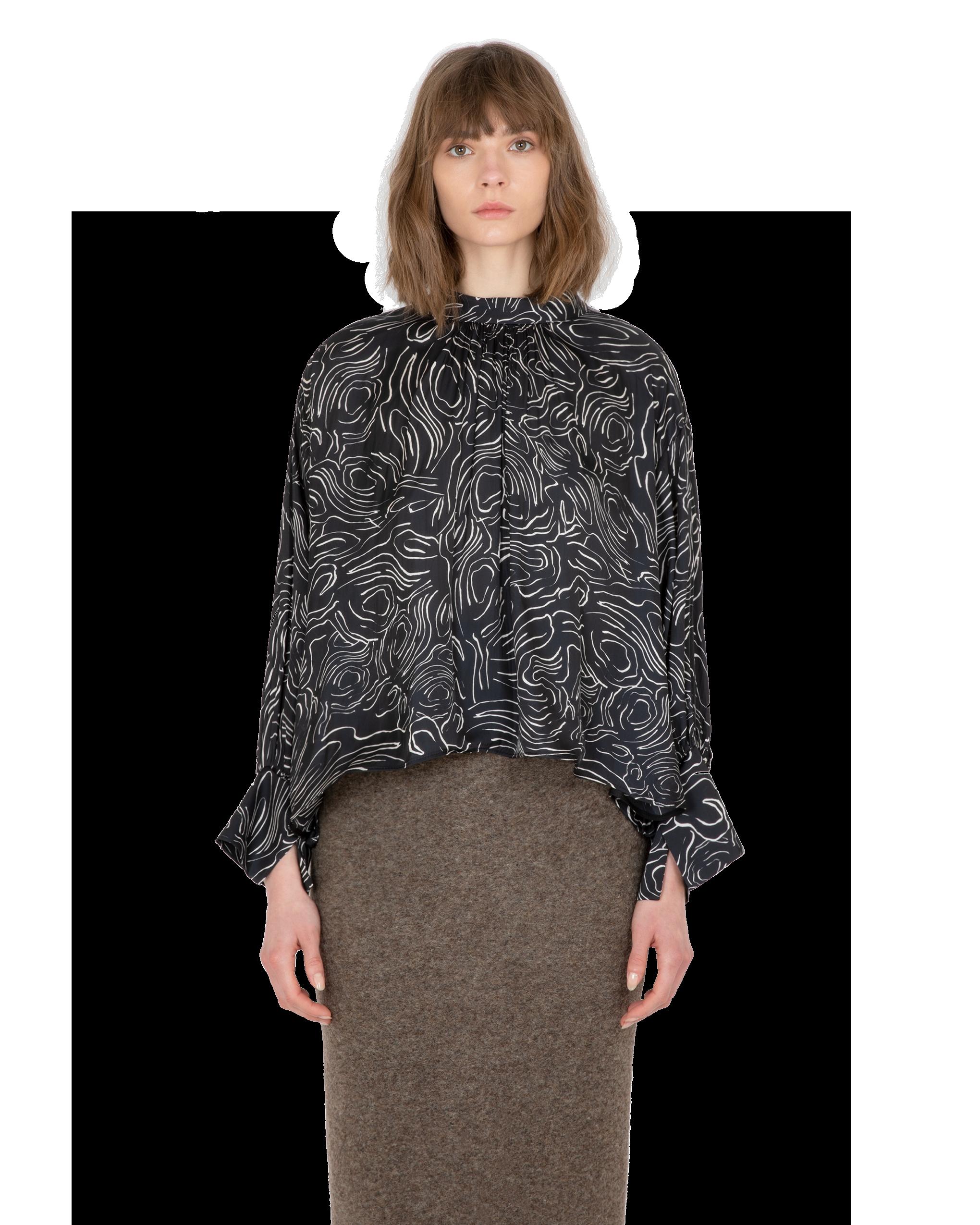 Model wearing EMIN + PAUL black volume blouse.