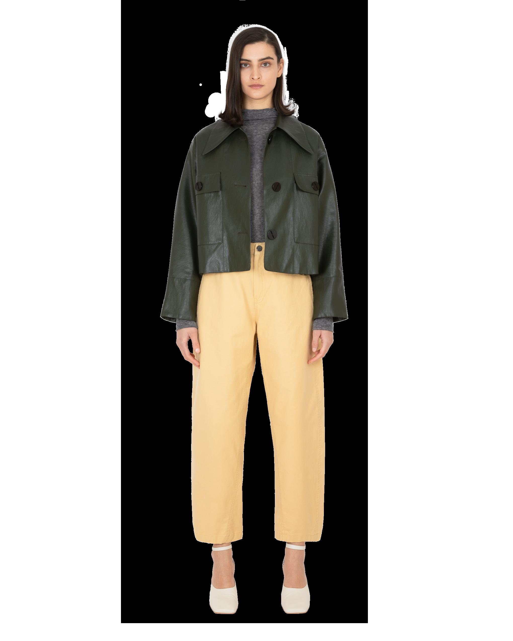 Model wearing EMIN + PAUL charcoal second skin wool blouse.