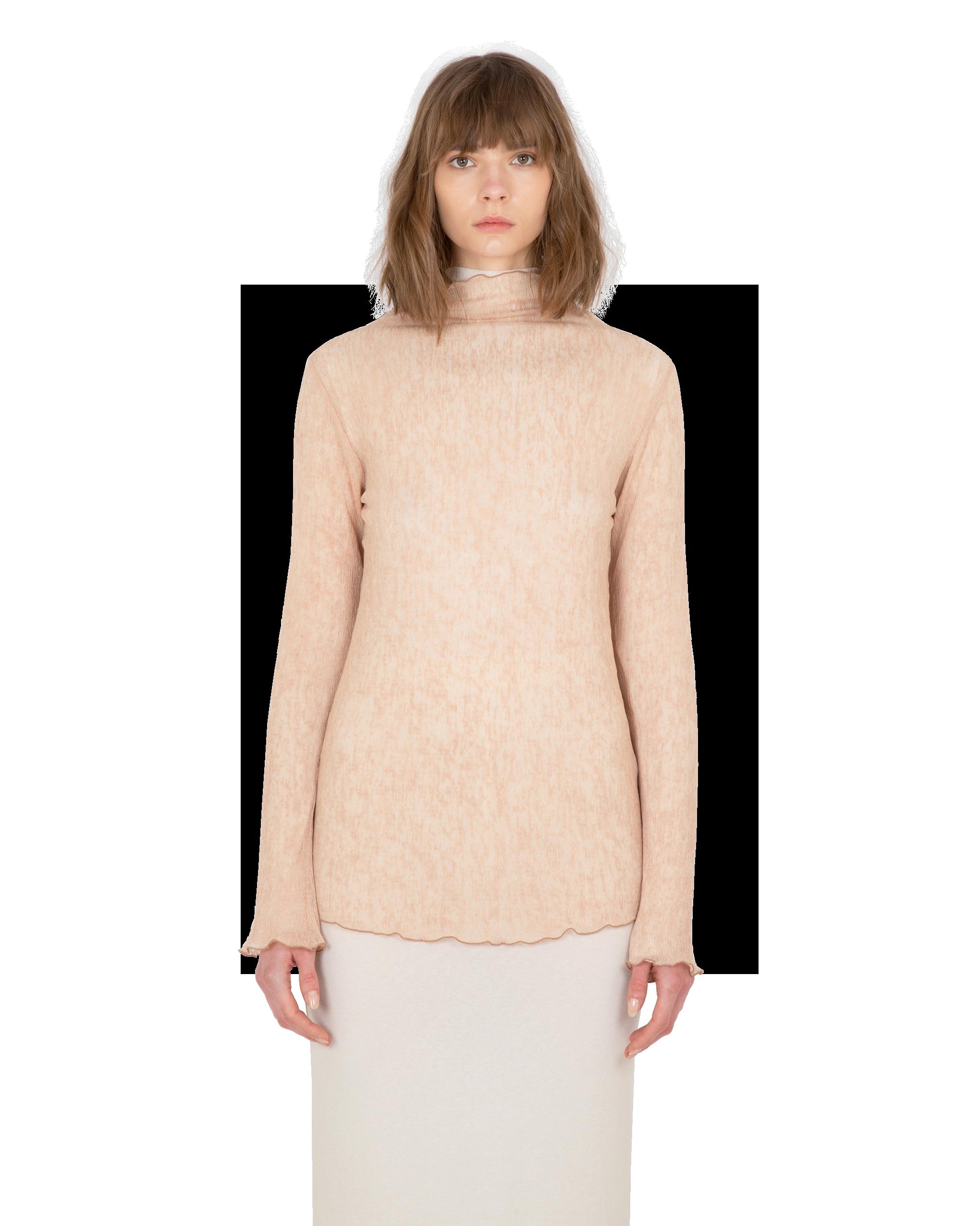 Model wearing EMIN + PAUL coral lettuce edge blouse.