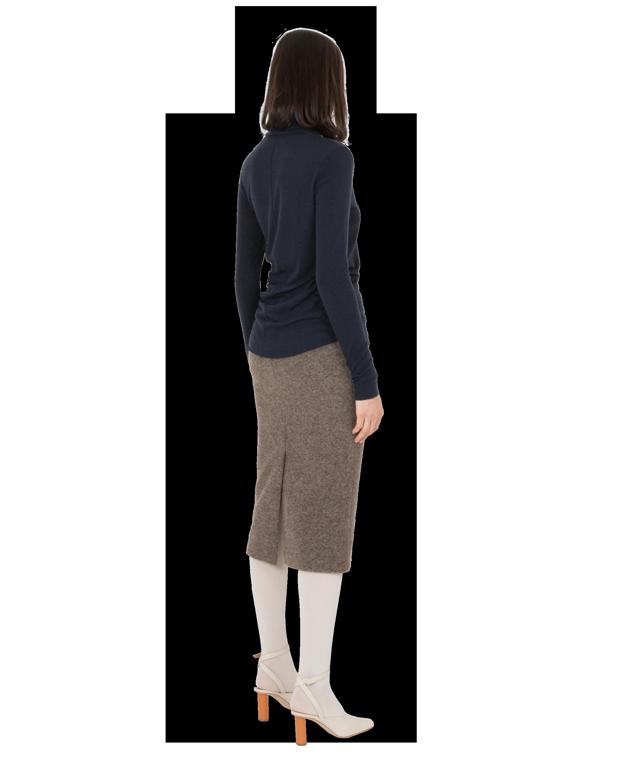 Model wearing EMIN + PAUL navy second skin wool blouse.