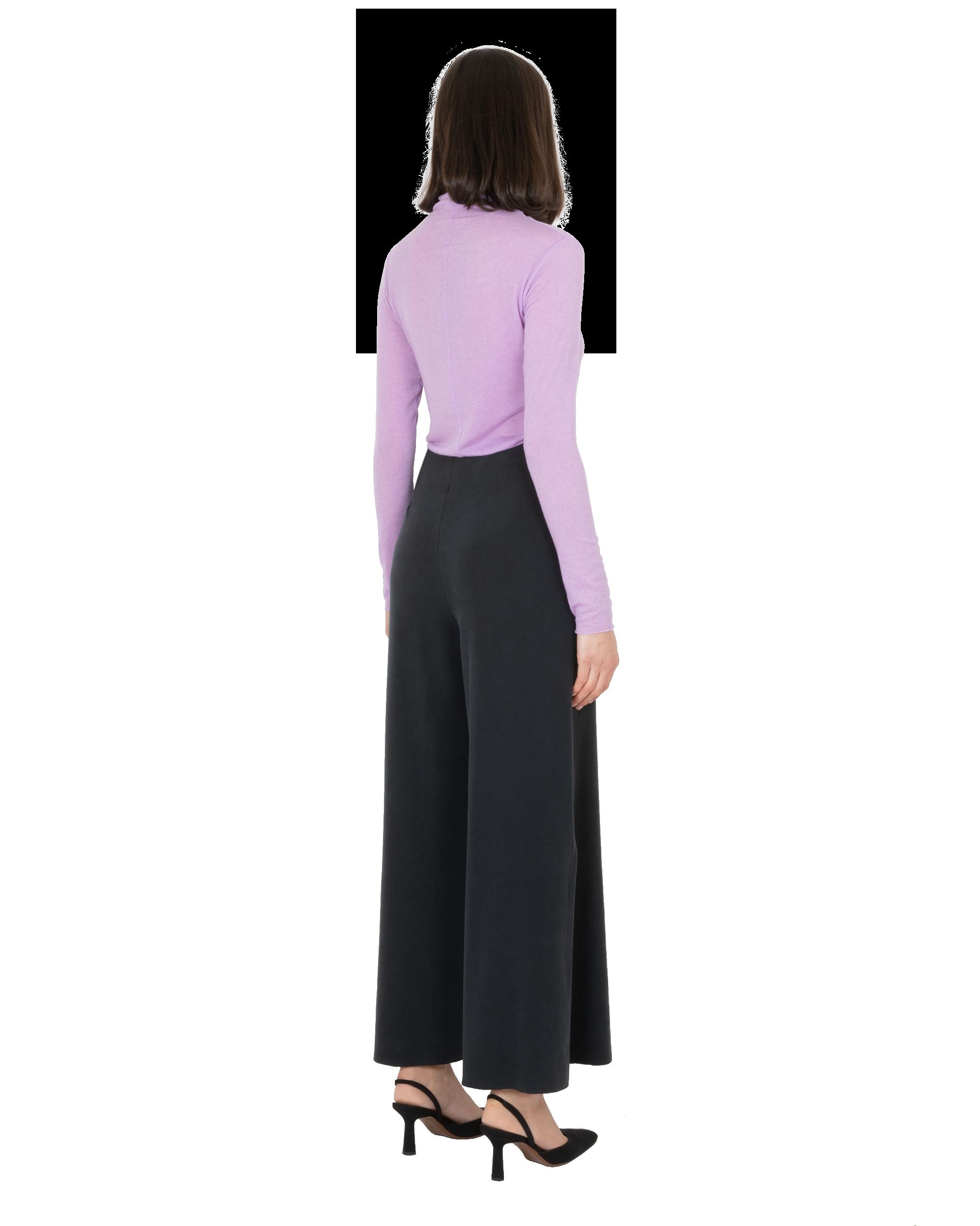Model wearing EMIN + PAUL violet second skin wool blouse.