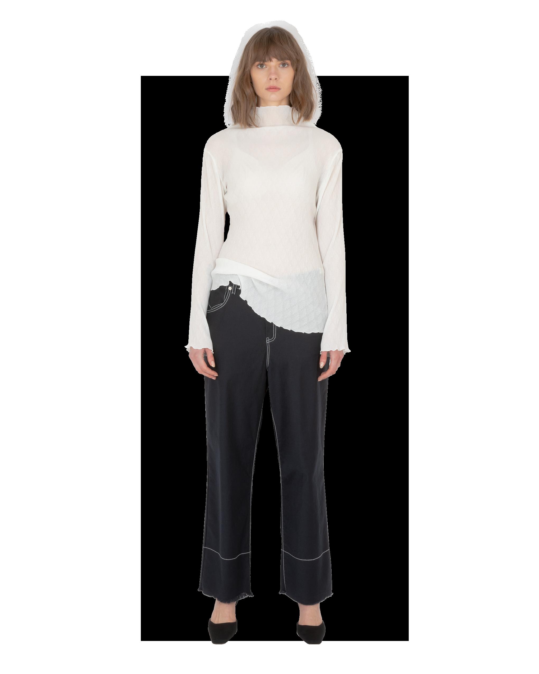Model wearing EMIN + PAUL white lettuce edge blouse.