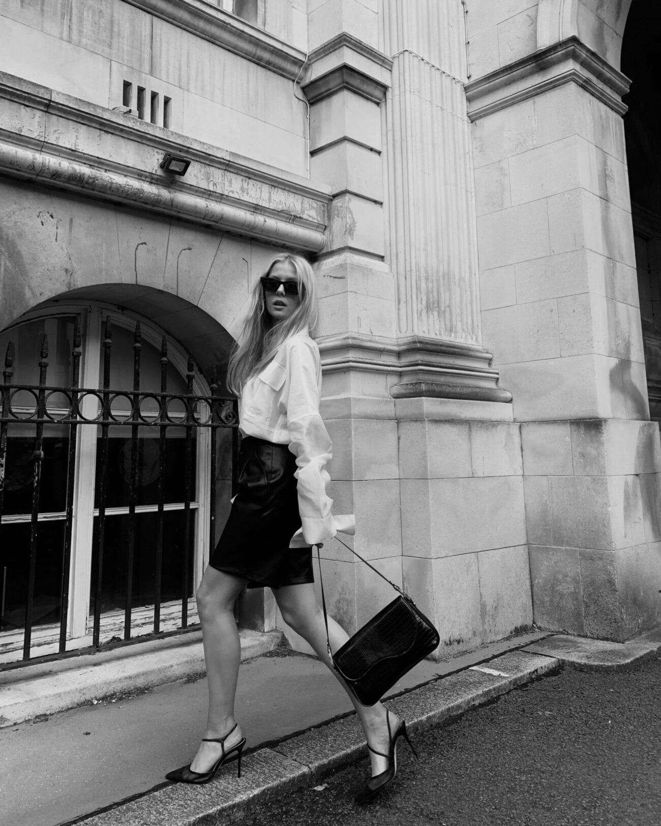 Millie Charles-Davies wearing EMIN + PAUL white ruched sleeve blouse.