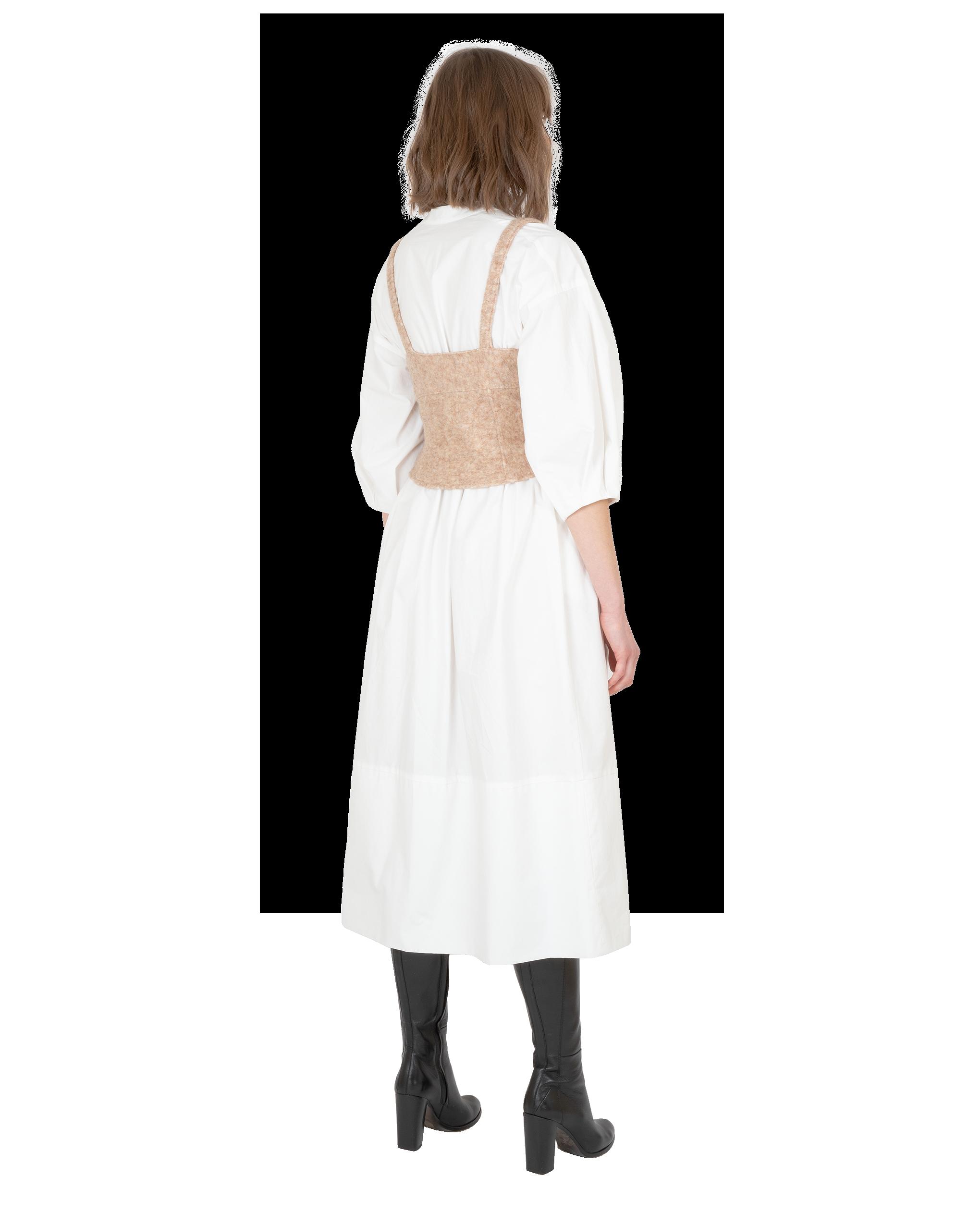 Model wearing EMIN + PAUL beige felted wool corset top.