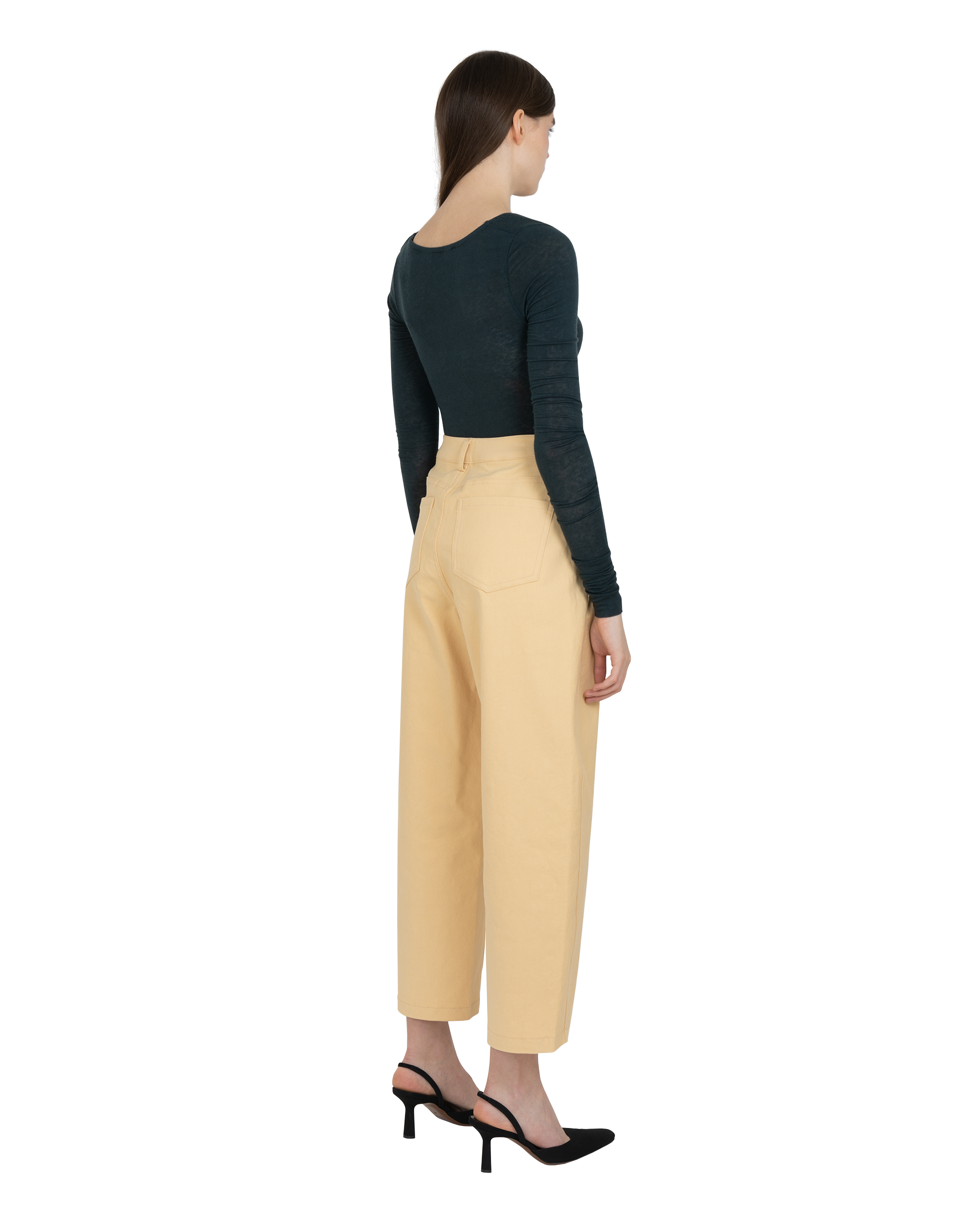 Model wearing EMIN + PAUL blue-green twist front bodysuit.