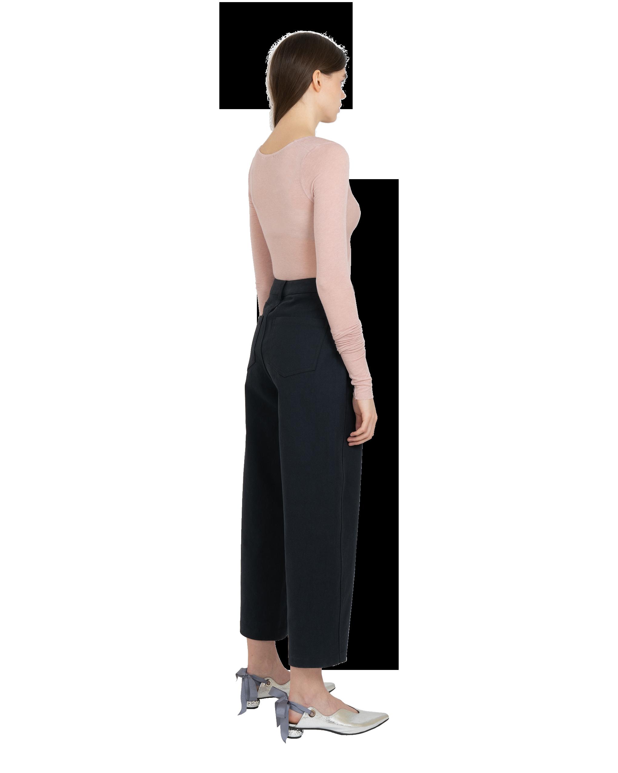 Model wearing EMIN + PAUL pink twist front bodysuit.
