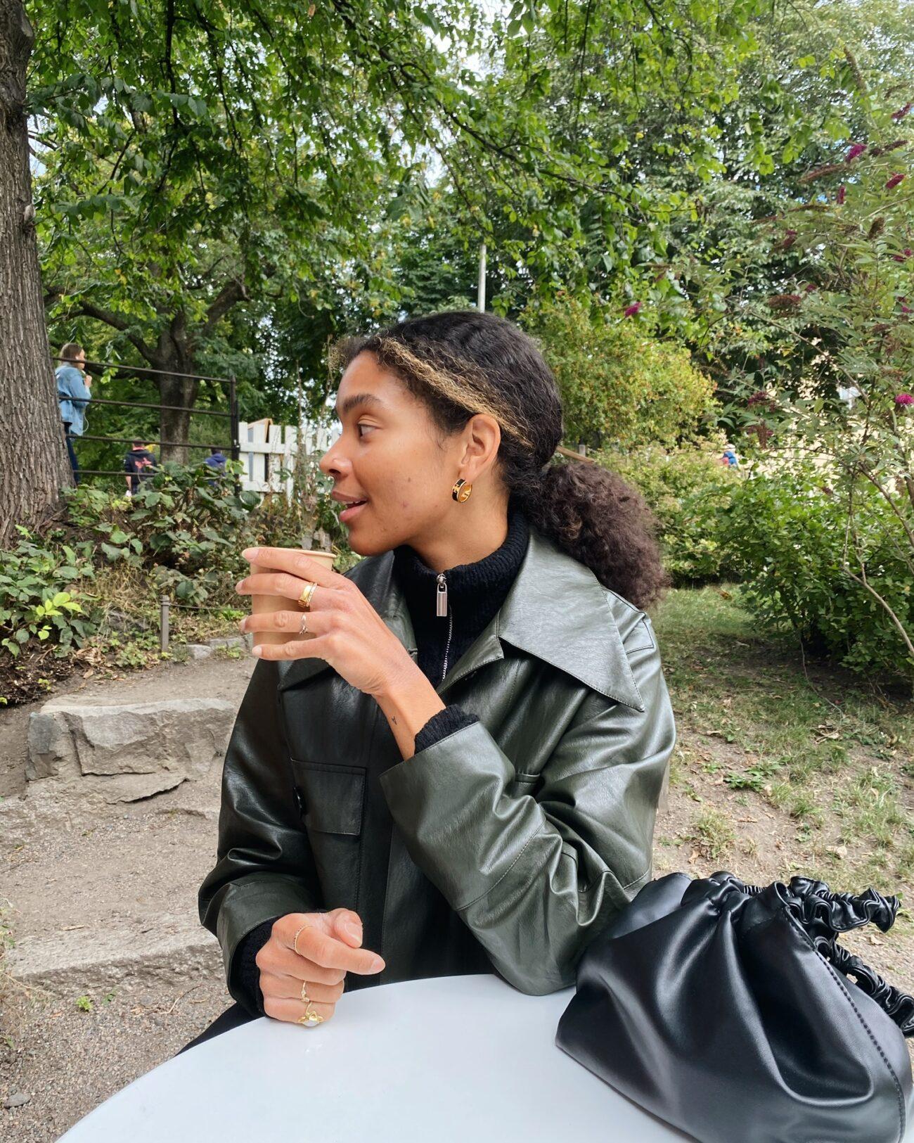Sara Flaaen wearing EMIN + PAUL khaki faux leather jacket.